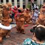 Dinosaurs dance in downtown Portland
