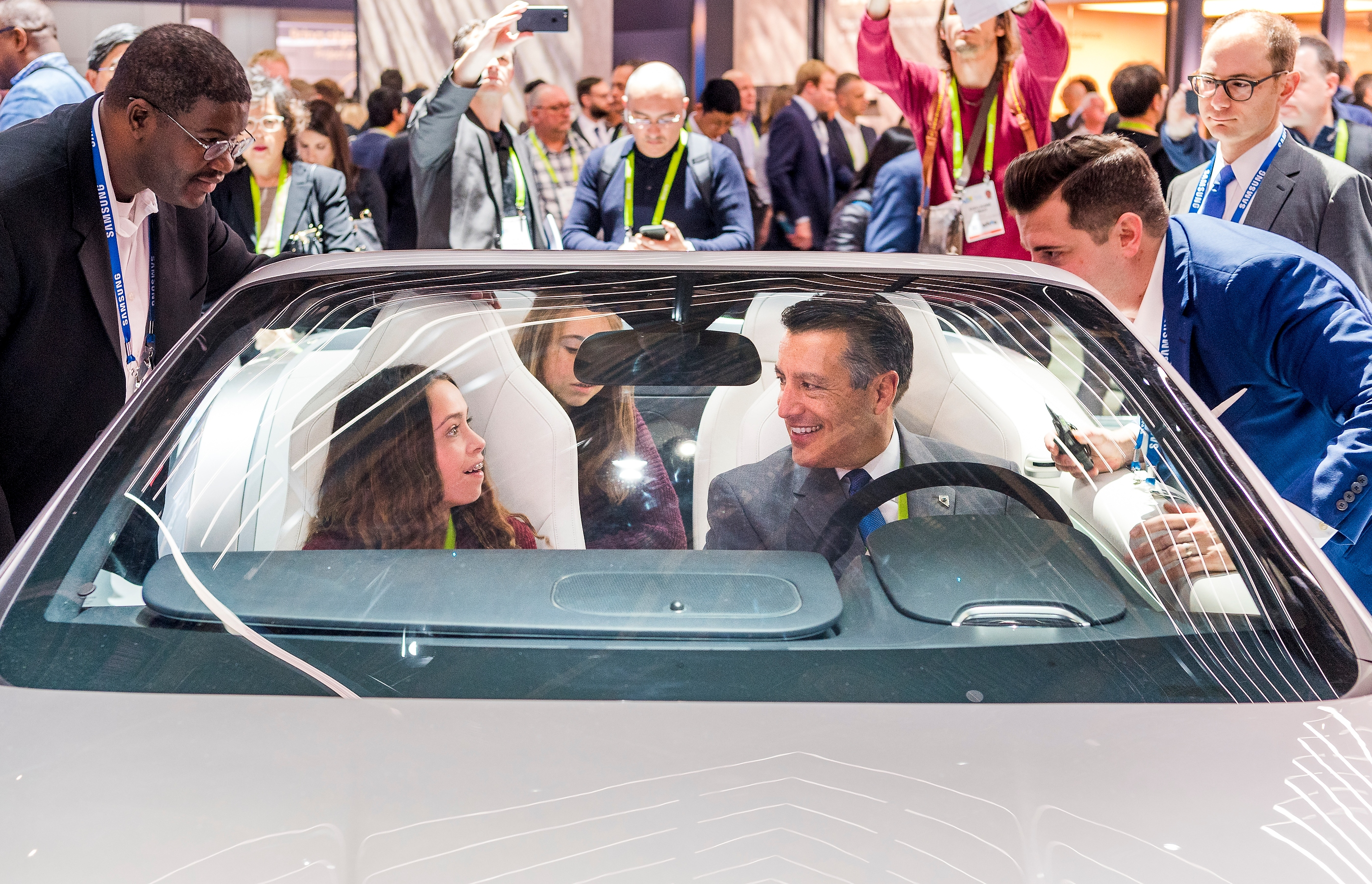 Nevada Governor Brian Sandoval, right, and daughter Marisa Sandoval check out the features of a high-tech Corvette in the Samsung booth at CES in the Las Vegas Convention Center on Thursday, Jan. 11, 2018. CREDIT: Mark Damon/Las Vegas News Bureau