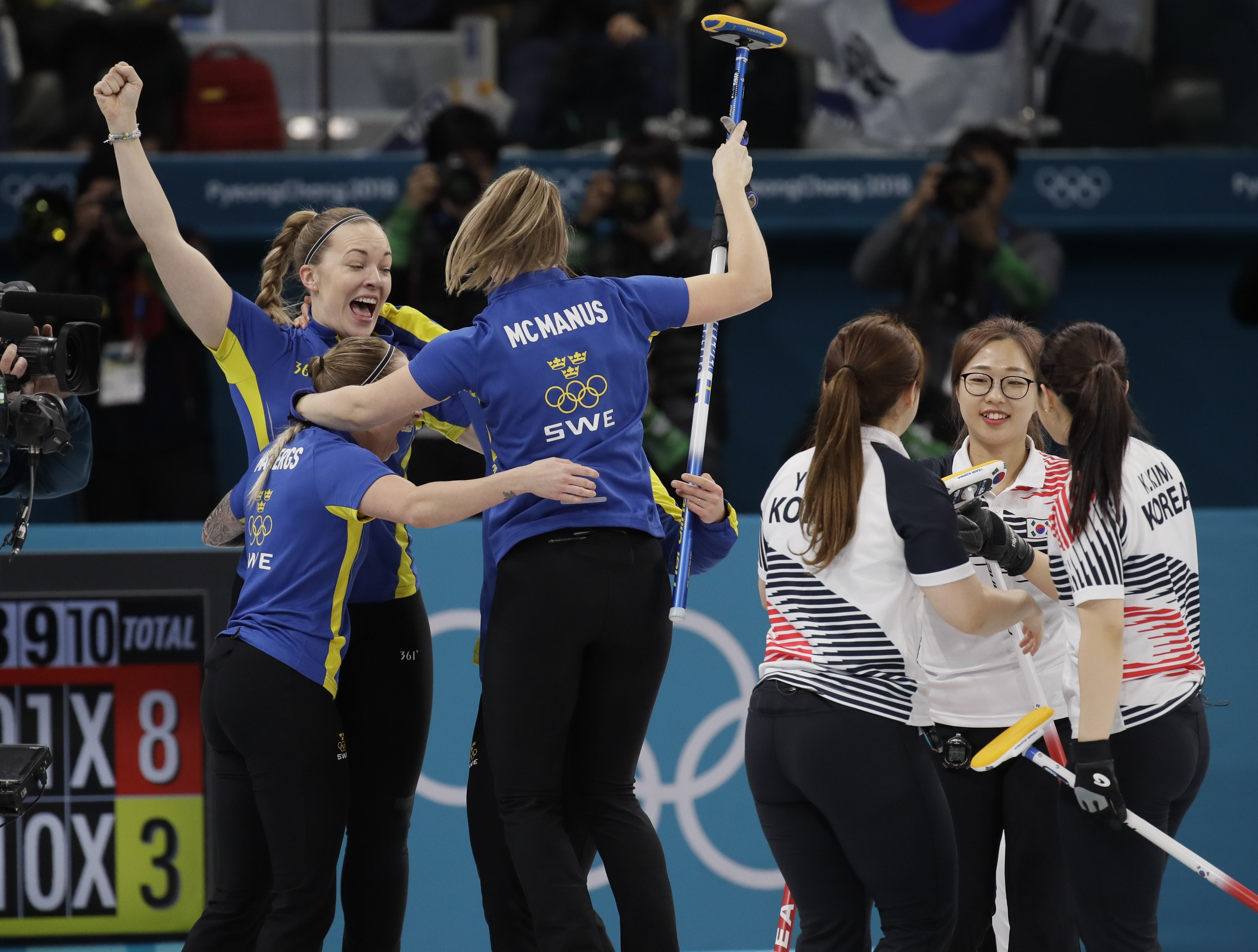 Sweden celebrates after winning the gold medal in their women's curling final in the Gangneung Curling Centre at the 2018 Winter Olympics in Gangneung, South Korea, Sunday, Feb. 25, 2018. (AP Photo/Aaron Favila)