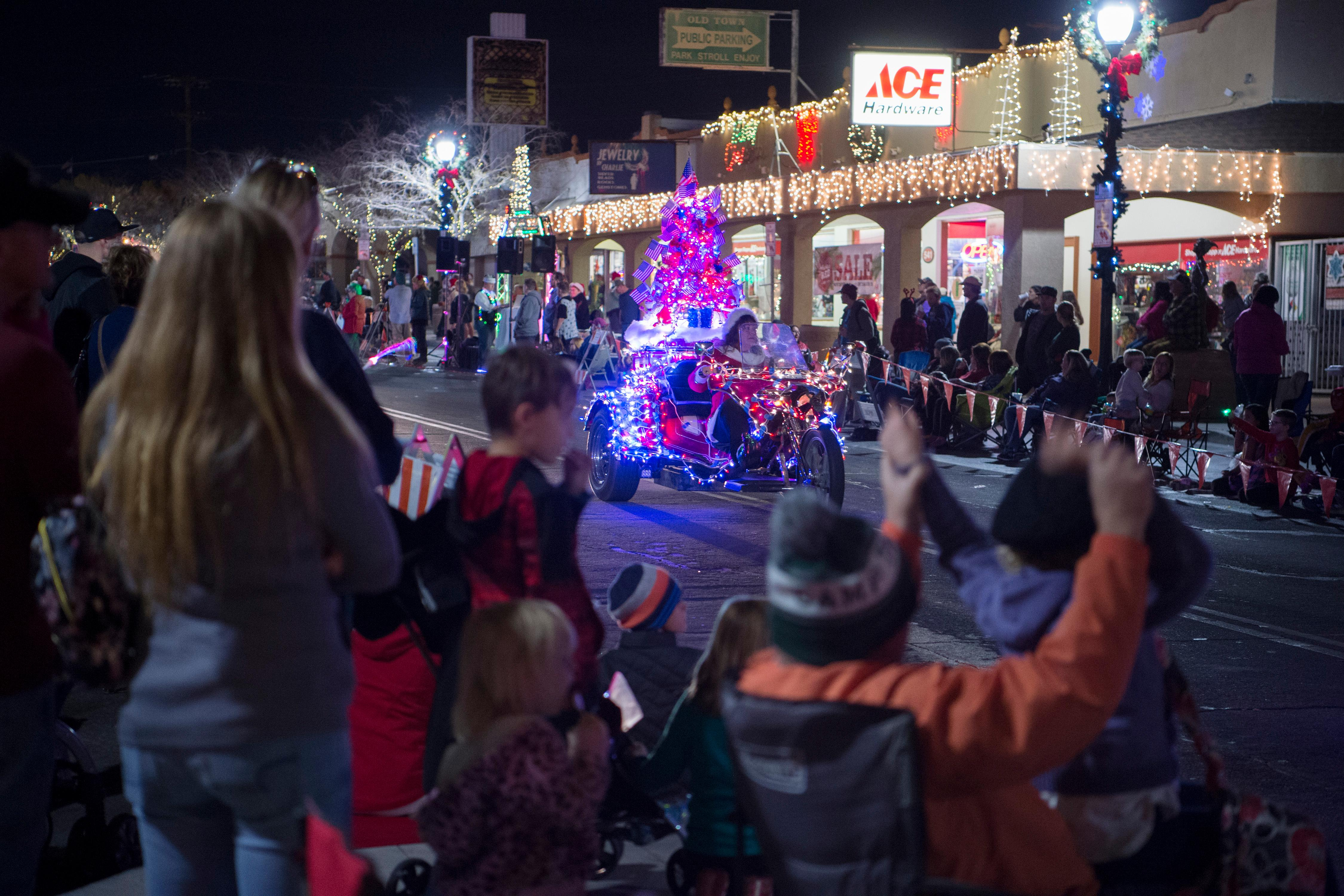 Onlookers watch illuminated vehicles during the Santa's Electric Parade Saturday, December 2, 2017, in Boulder City. [Sam Morris/Las Vegas News Bureau]