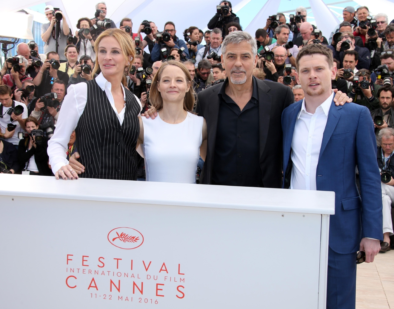 Director Jodie Foster, second left, poses for photographers with from left, actress Julia Roberts, actors George Clooney and Jack OÂ?Connell, during a photo call for the film Money Monster at the 69th international film festival, Cannes, southern France, Thursday, May 12, 2016. (AP Photo/Joel Ryan)