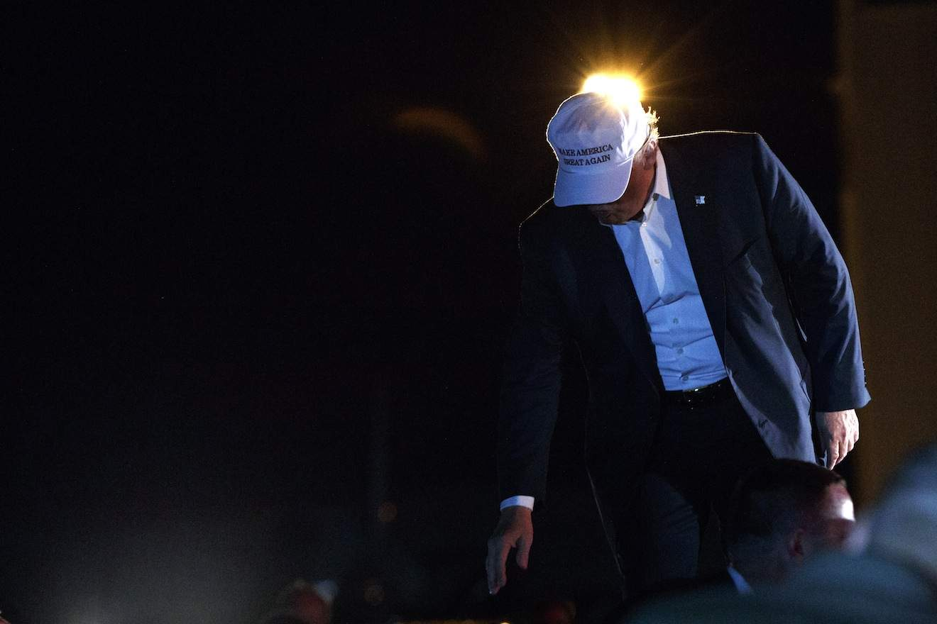Republican presidential candidate Donald Trump exits the stage after speaking during a campaign rally, Saturday, Sept. 17, 2016, in Colorado Springs, Colo. (AP Photo/ Evan Vucci)
