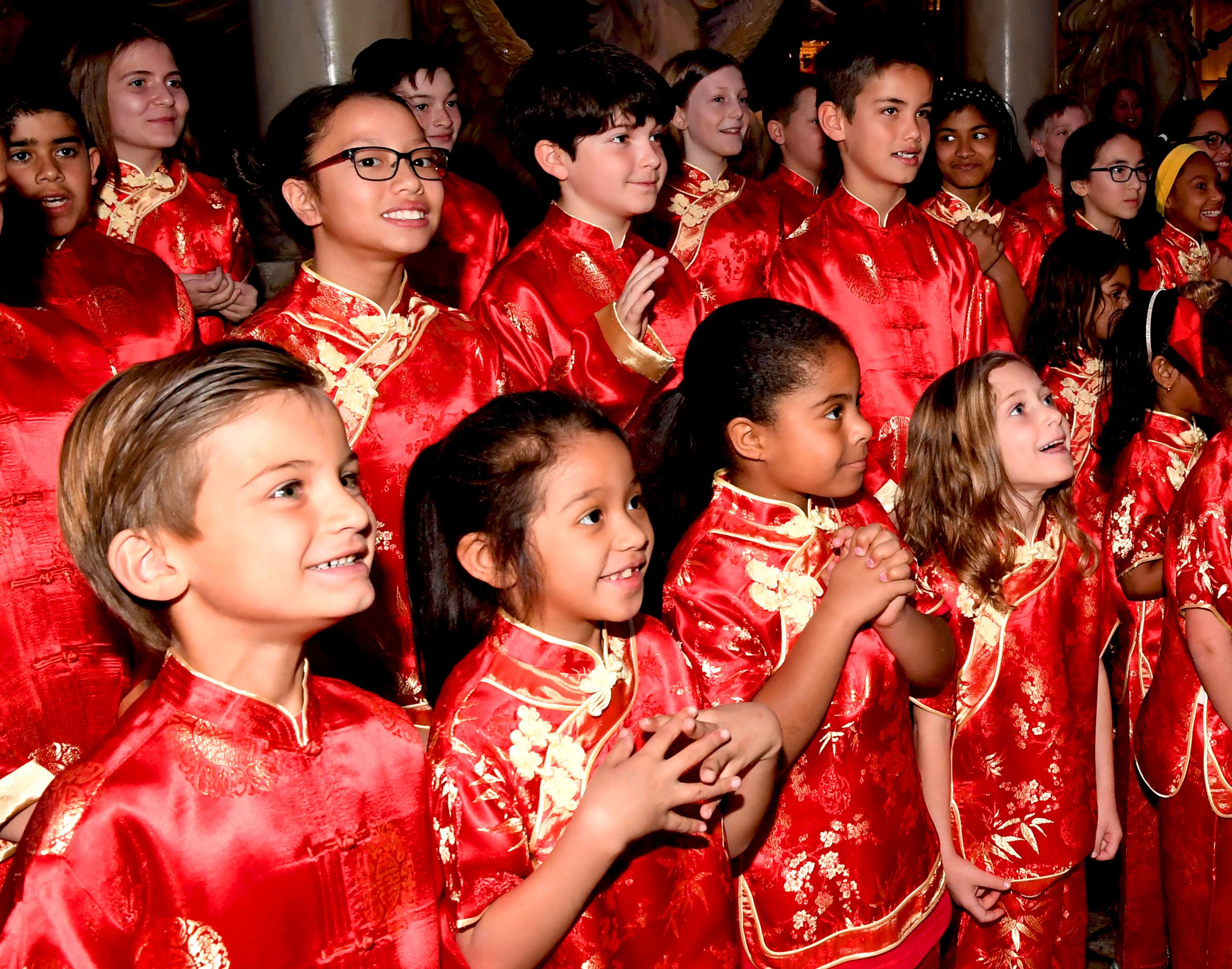 Meadows School 22nd Annual Dragon Parade in honor of Chinese New Year, the Year of the Dog, at Caesars Forum Shops. At the end of the parade students are treated to a surprise Year of the Dog cake from Freeds Bakery. Thursday, February 16, 2018. CREDIT: Glenn Pinkerton/Las Vegas News Bureau