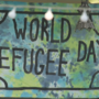 Dozens gather for late World Refugee Day celebration