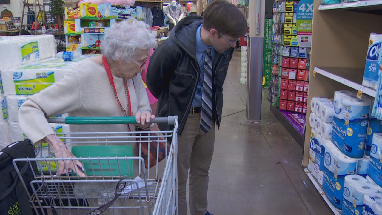 Jean and Ian Parker shop for toilet paper for one of Store to Door's customers.