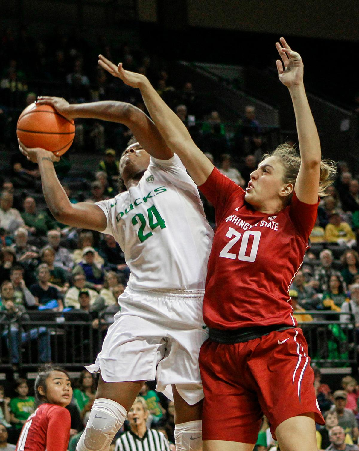 Washington State University Cougars Maria Kostourkova (#20) attempts to block the shot of Oregon Ducks Ruthy Hebard (#24). In their first conference basketball game of the season, the Oregon Women Ducks defeated the Washington State Cougars 89-56 in Matt Knight Arena Saturday afternoon. Oregon's Ruthy Hebard ran up 25 points with 10 rebounds. Sabrina Ionescu shot 25 points with five three-pointers and three rebounds. Lexi Bando added 18 points, with four three-pointers and pulled down three rebounds. Satou Sabally ended the game with 14 points with one three-pointer and two rebounds. The Ducks are now 12-2 overall with 1-0 in conference and the Cougars stand at 7-6 overall and 0-1 in conference play. The Oregon Women Ducks next play the University of Washington Huskies at 1:00 pm on Sunday. Photo by Rhianna Gelhart, Oregon News Lab