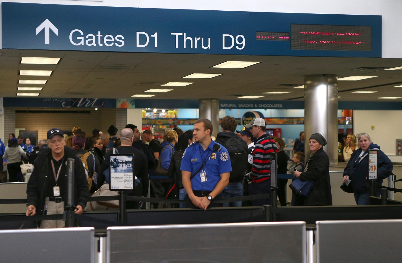 Crowds line up at Fort Lauderdale-Hollywood International Airport in Terminal 2 on Monday, Jan. 9, 2017 the three after multiple people were shot at the airport. (David Santiago/El Nuevo Herald via AP)<p></p>