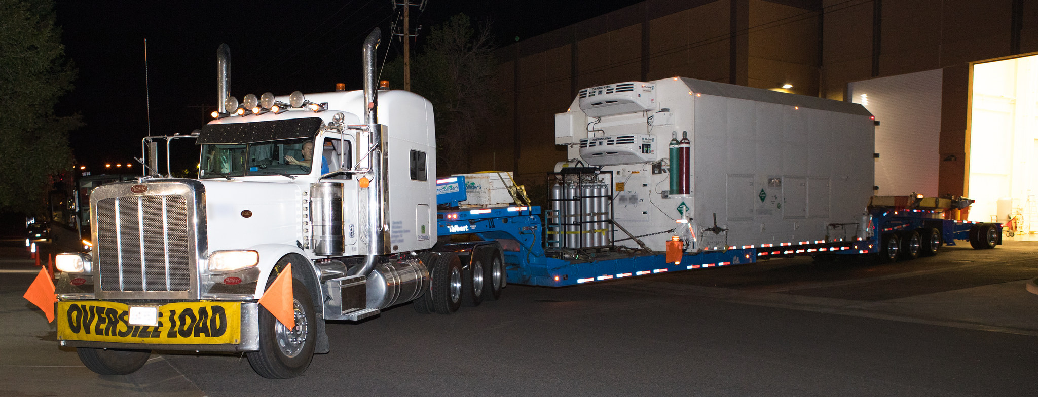 A truck carrying the shipping crate containing JPSS-1 leaves the Ball facility and begins its 1,200-mile journey to California's Vandenberg Air Force Base. (NASA Photo)