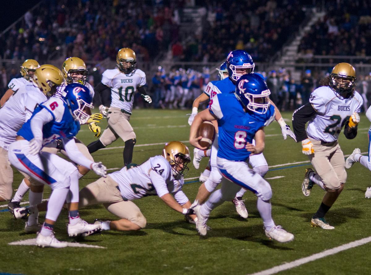 Churchill Lancers running back Dalton McDaniel (#8) slips away from Pendleton Buckeroos linebacker Brendon Bedolla (#24). The Churchill Lancers defeated the Pendleton Buckaroos 42-15, in the first round of the state 5A playoffs. Photo by Dan Morrison, Oregon News Lab