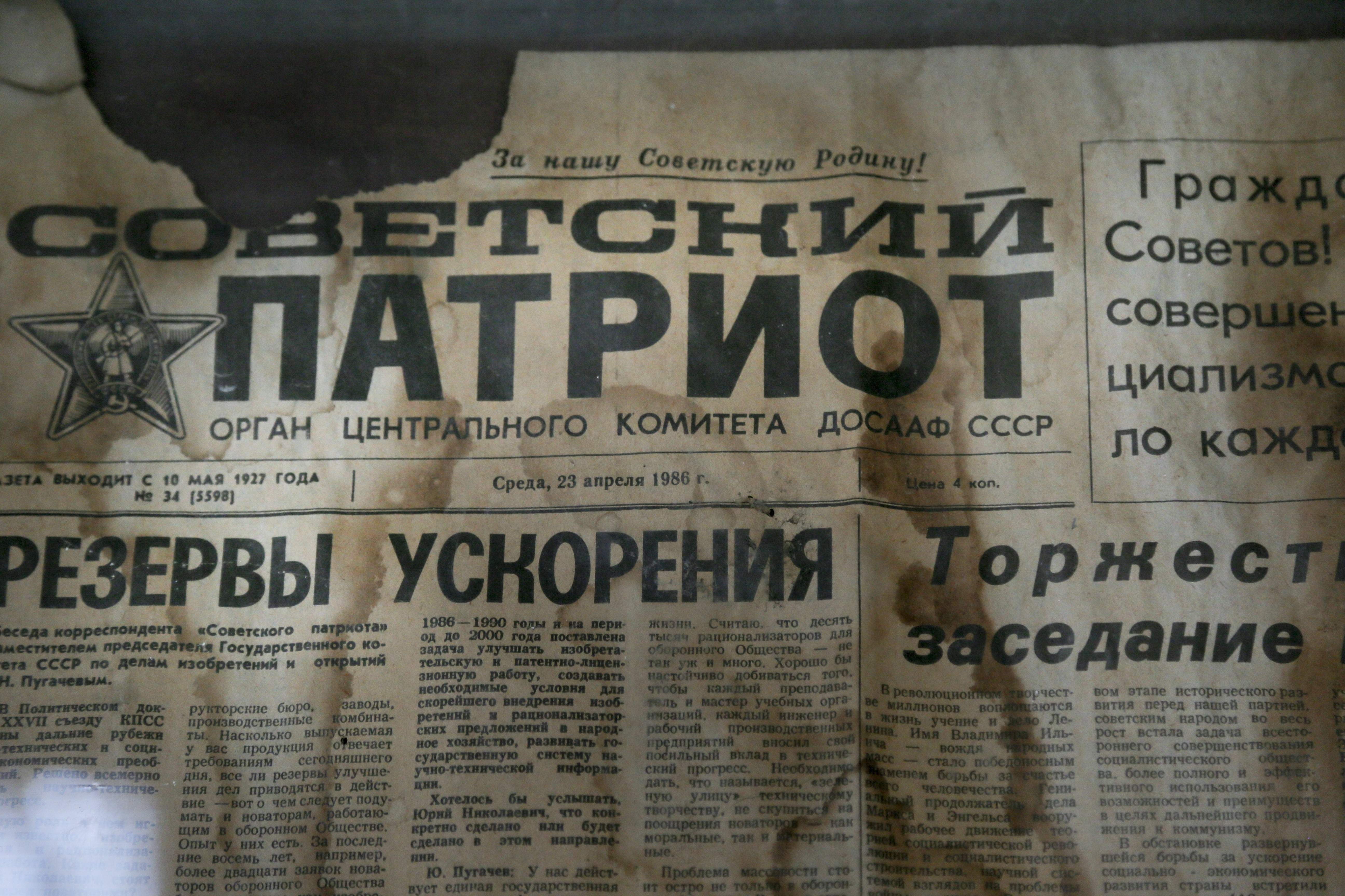 In this photo taken Wednesday, April 5, 2017, an edition of the newspaper Sovetsky Patriot, dated three days before the nuclear explosion, is attached to a bulletin board in a house of culture in the deserted town of Pripyat, some 3 kilometers (1.86 miles) from the Chernobyl nuclear power plant Ukraine. Once home to some 50,000 people whose lives were connected to the Chernobyl nuclear power plant, Pripyat was hastily evacuated one day after a reactor at the plant 3 kilometers (2 miles away) exploded on April 26, 1986. The explosion and the subsequent fire spewed a radioactive plume over much of northern Europe. THE ASSOCIATED PRESS