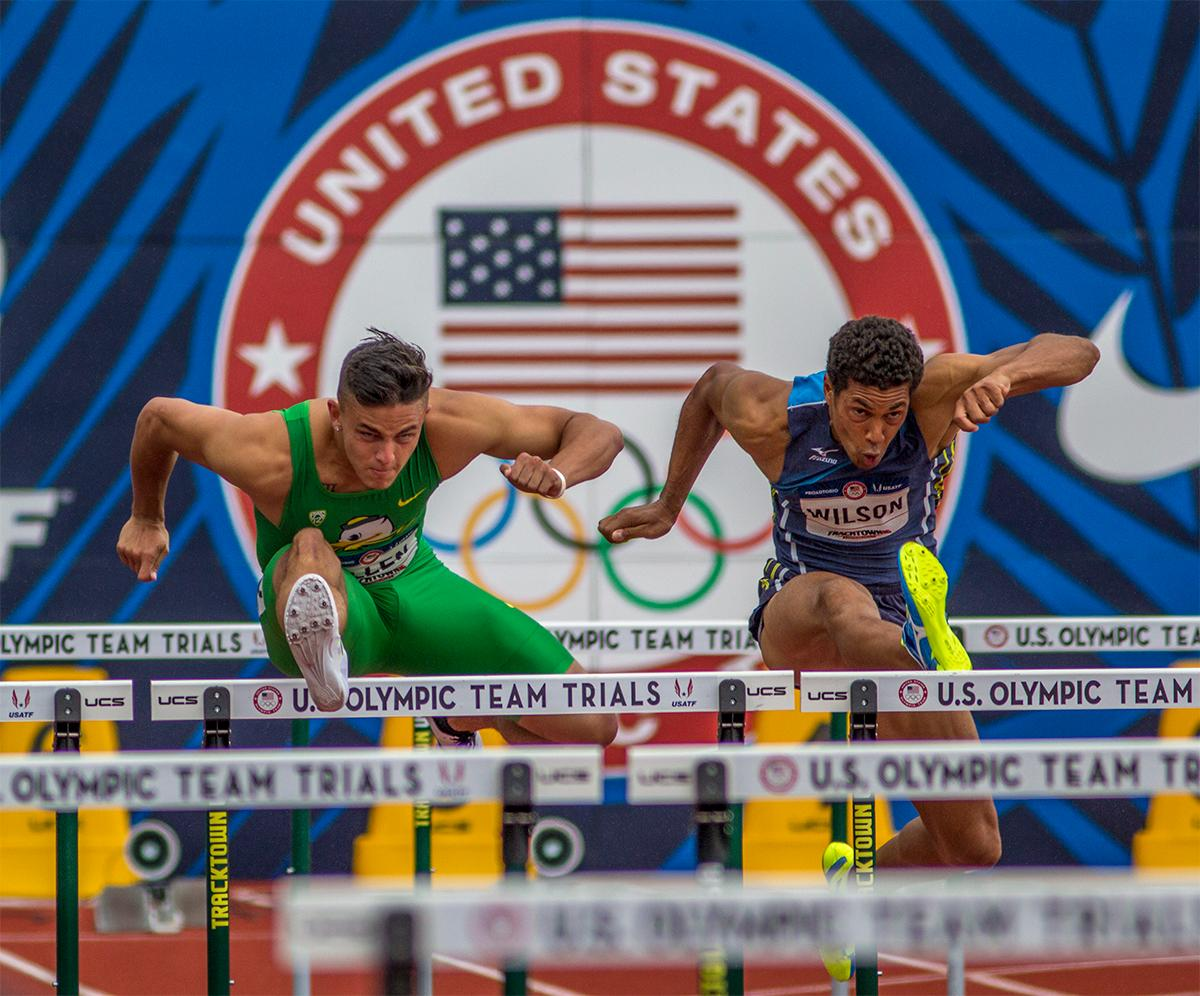 Oregon's Devon Allen flies over the hurdles to a heat victory. Allen won his heat with a time of 13.44 and placed third overall. Photo by August Frank, Oregon News Lab