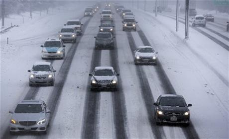 Motorists drive along a snow covered northbound Interstate-94 in Chicago on Sunday, Jan. 5, 2014. Sunday night temperatures will drastically drop to about minus 20 degrees.