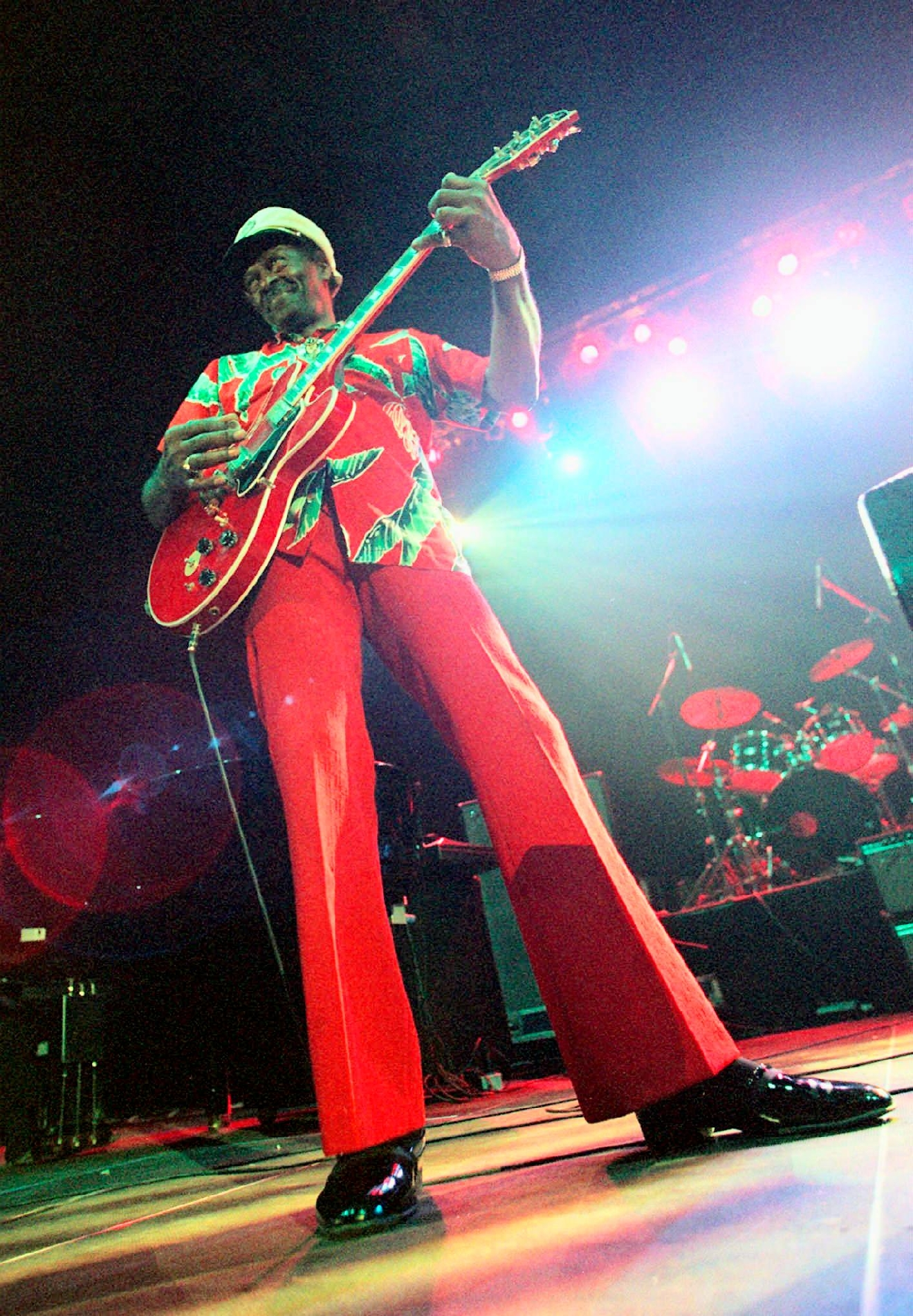 "FILE - In this Tuesday, July 28, 199 file photo, Chuck Berry performs during the ""Legends of Rock 'n' Roll"" at the Hallenstadion in Zurich, Switzerland. Berry headlined the show that also featured appearances by Little Richard and Jerry Lee Lewis. On Saturday, March 18, 2017, police in Missouri said Berry has died at the age of 90. (Michele Limina/Keystone via AP)"