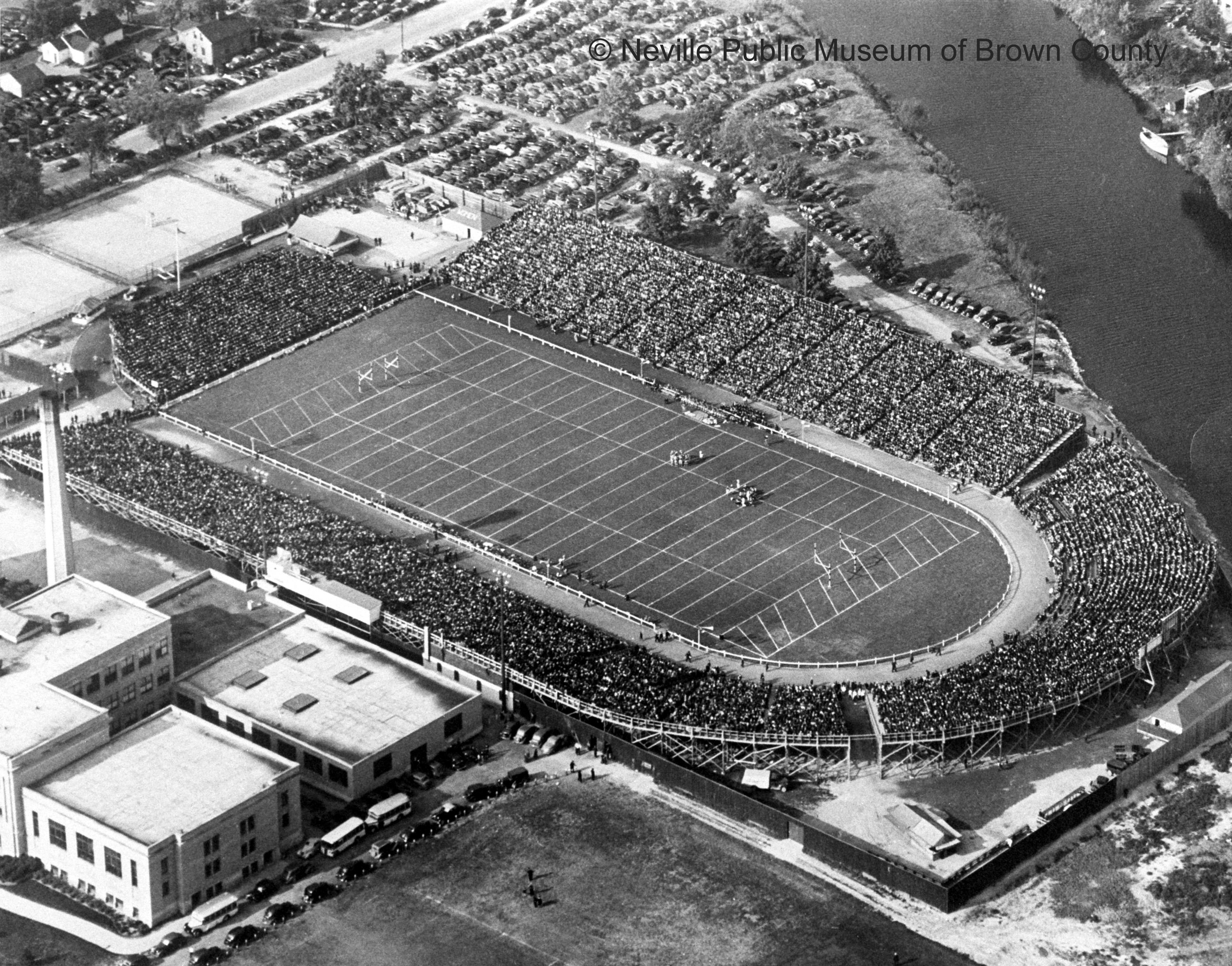 City Stadium at its peak capacity of 25,000 with its final horseshoe-shaped design. The field is still used today by Green Bay East High School, but the wooden stands have been replaced with far less seating. The horseshoe-shaped design no longer exists. (Courtesy: Neville Public Museum of Brown County)