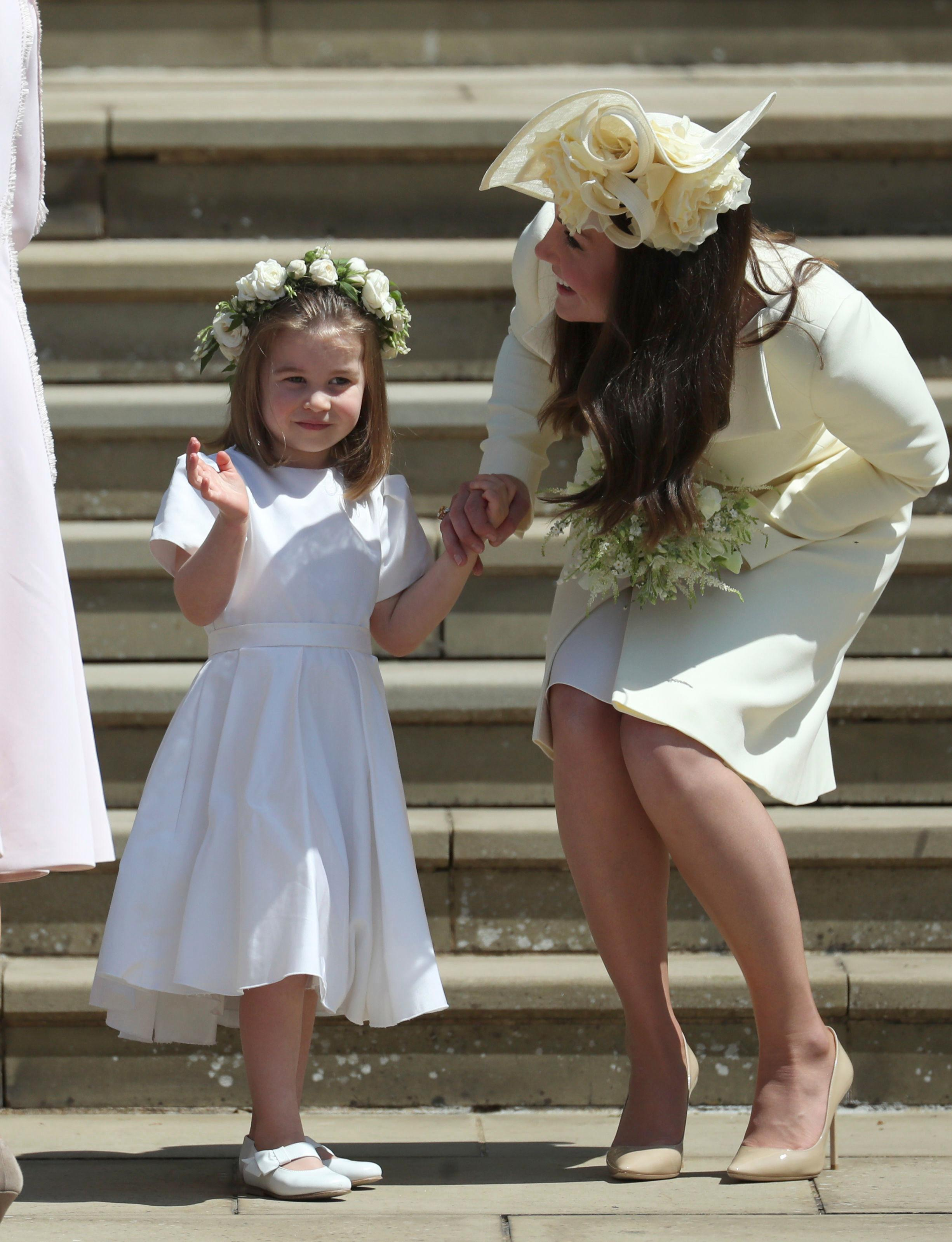 Princess Charlotte and Kate, Duchess of Cambridge after  the wedding ceremony of Prince Harry and Meghan Markle at St. George's Chapel in Windsor Castle in Windsor, near London, England, Saturday, May 19, 2018. (Jane Barlow/pool photo via AP)
