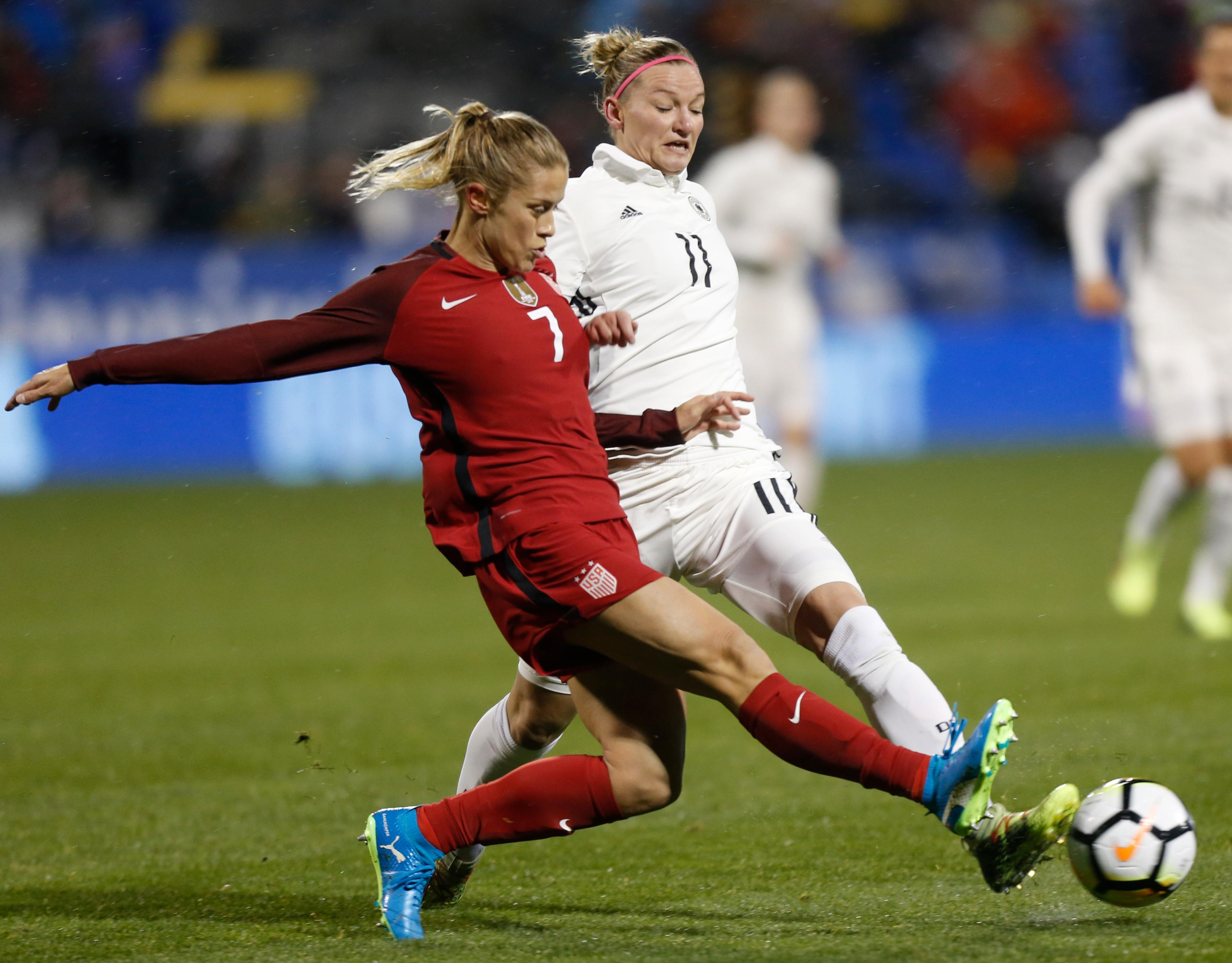 United States' Abby Dahlkemper, left, tries to clear the ball away from Germany's Alexandra Popp during the first half of a SheBelieves Cup women's soccer match Thursday, March 1, 2018, in Columbus, Ohio. (AP Photo/Jay LaPrete)