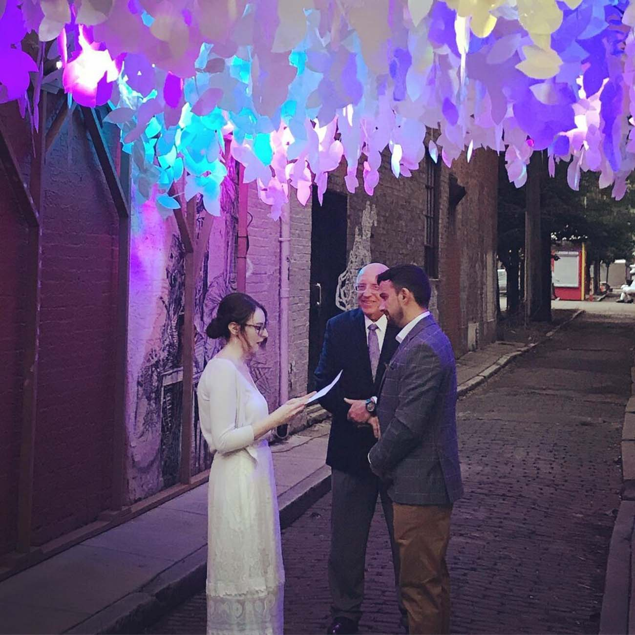 A couple getting married under Jessica's BLINK sculpture, Arborealis. / Image courtesy of Paper Acorn // Published: 6.18.20