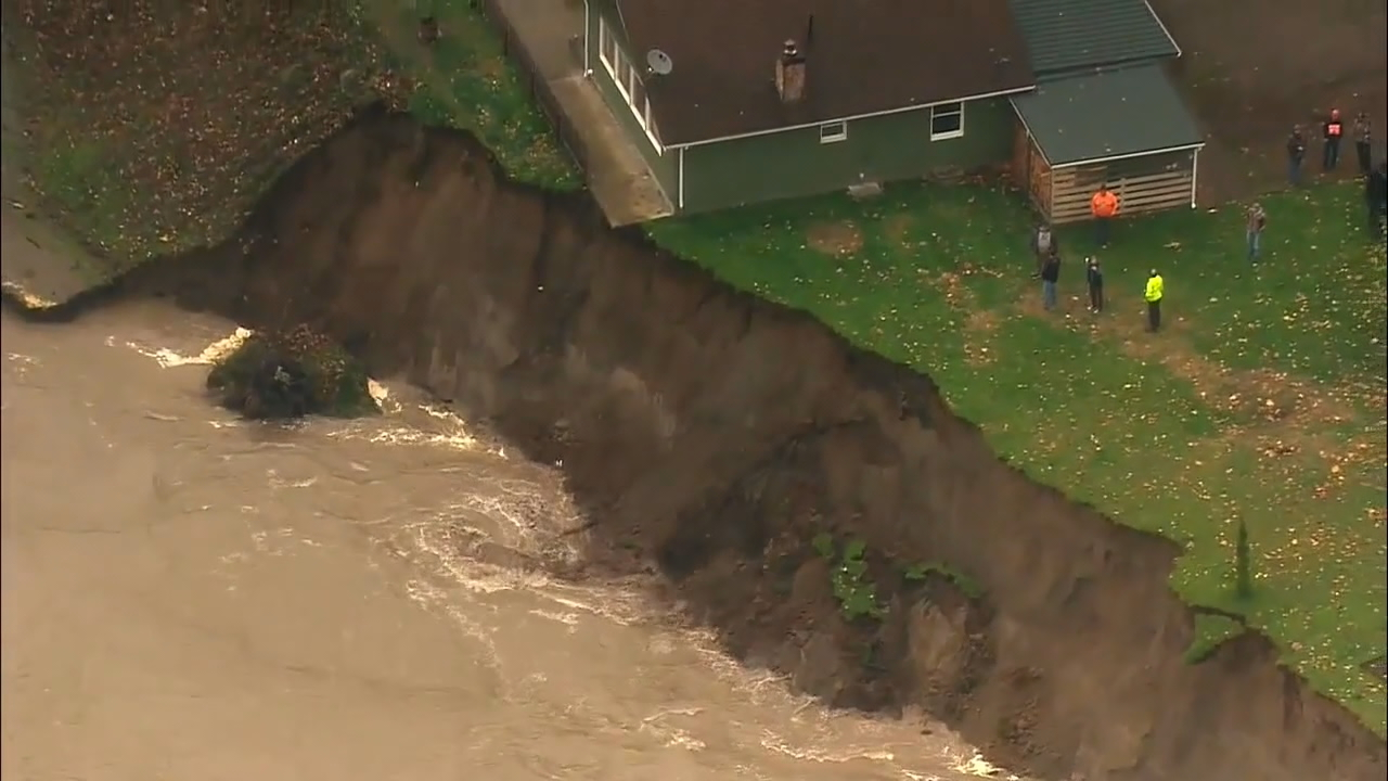 Neighbors who have been pushed out of their homes along the Skagit River are now forced to watch and wait. It's not yet clear if the city of Lyman will get the federal resources it needs to shore up the eroding river bank. (Photo: KOMO News/Air 4)