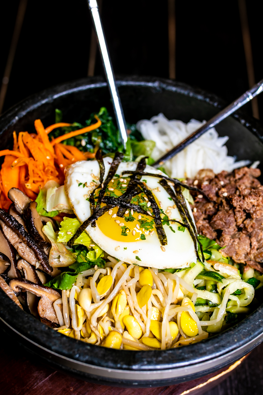 Dolsot Bibimbap: Steamed rice topped with spinach, radish, carrot, bean sprout, zucchini, mushroom, and your choice of meat (beef or chicken), or tofu, with a fried egg on top served in a sizzling hot stone bowl (homemade hot sauce on the side) / Image: Amy Elisabeth Spasoff // Published: 8.31.18