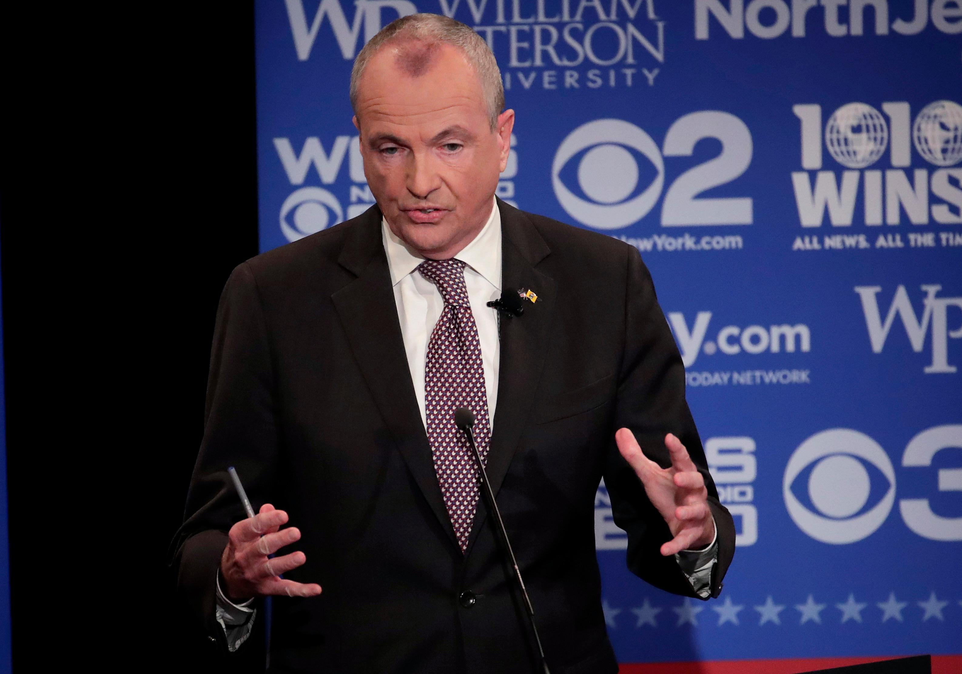 FILE - In this Oct. 18, 2017, file photo, Democratic nominee Phil Murphy participates in a gubernatorial debate against Republican nominee Lt. Gov. Kim Guadagno at William Paterson University, in Wayne, N.J. Voters in Virginia and New Jersey are picking new governors in contests that could be an early referendum on President Donald Trump. The two gubernatorial elections on Tuesday, Nov. 7, pit two mild-mannered Democrats against two Republicans who have kept the president at arm's length. (AP Photo/Julio Cortez, Pool, File)