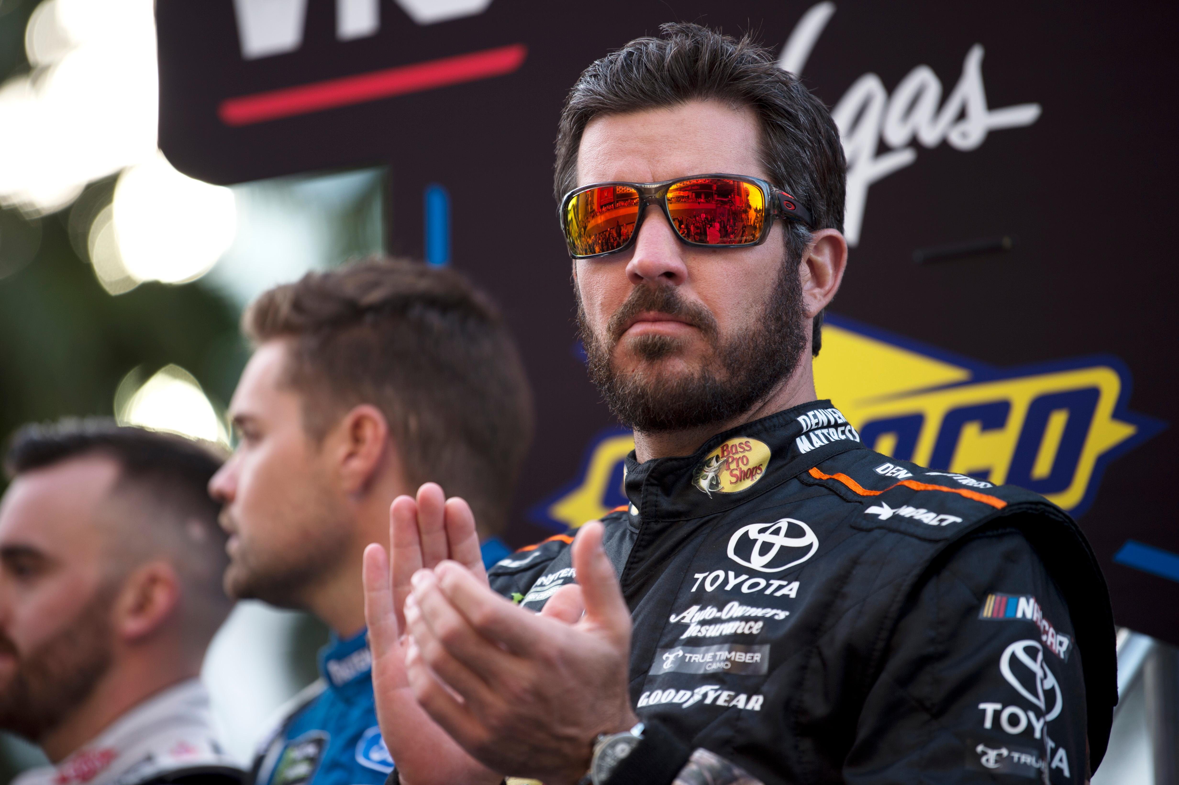 Season champion Martin Truex Jr. applauds during the NASCAR Victory Lap on the Las Vegas Strip being held as part of Champions Week Wednesday, November 29, 2017. CREDIT: Sam Morris/Las Vegas News Bureau