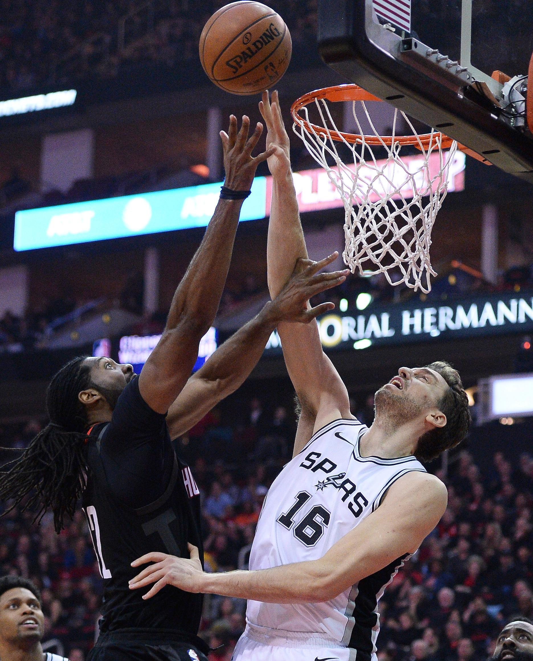 San Antonio Spurs center Pau Gasol (16) blocks a shot by Houston Rockets Nene (42) in the first half of an NBA basketball game Friday, Dec. 15, 2017, in Houston. (AP Photo/George Bridges)