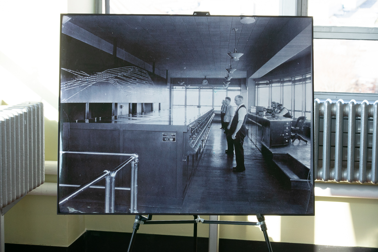 Here's a photo of Tower A as it once looked when it was still being used to manage the flow of trains into and out of Union Terminal. Notice the train director at the desk to the right and the lever men awaiting orders next to the massive interlocking machine. This photo stands on an easel inside Tower A today. // Published: 1.17.20
