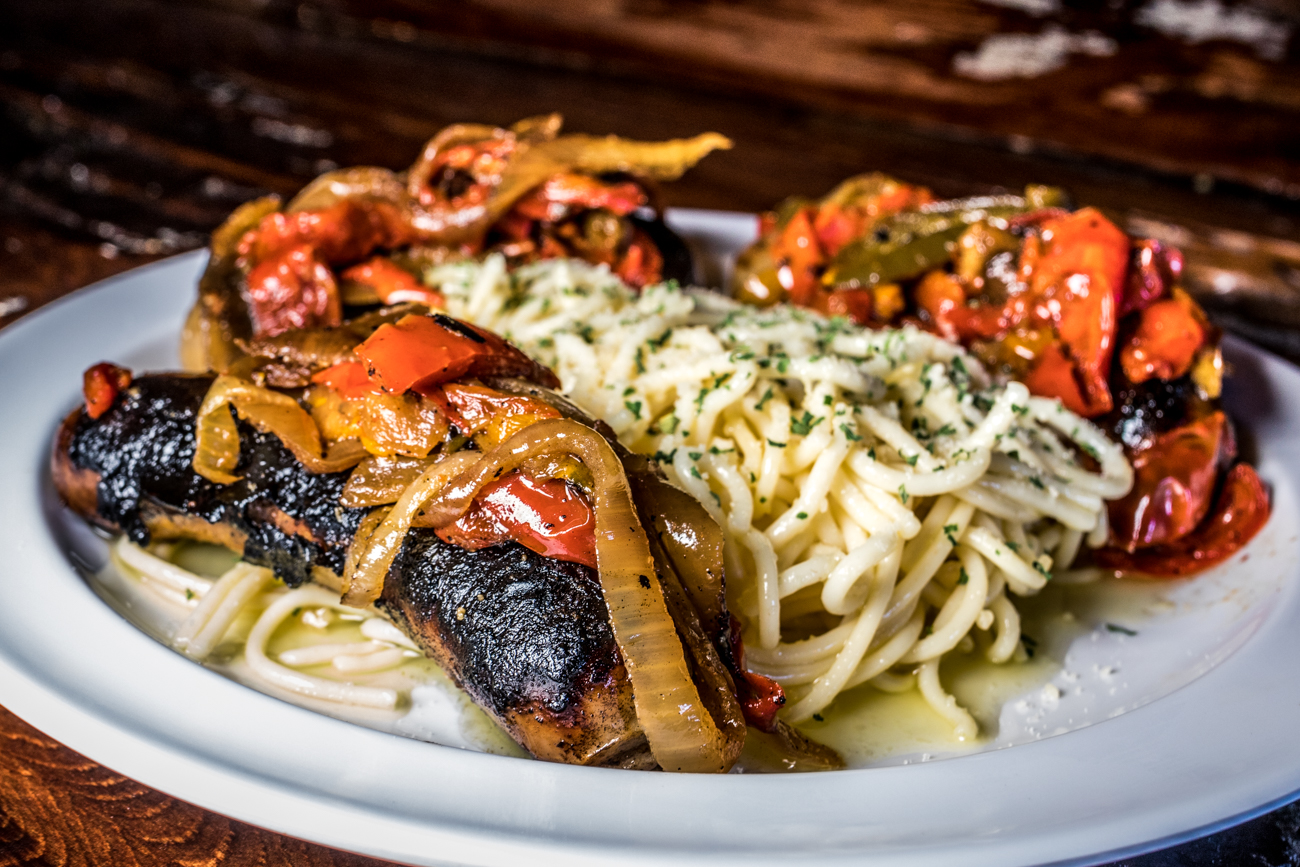 Italian Sausage and Peppers: grilled Italian sausage with grilled peppers and onions and served with spaghetti tossed in olive oil and herbs / Image: Catherine Viox // Published: 2.3.20