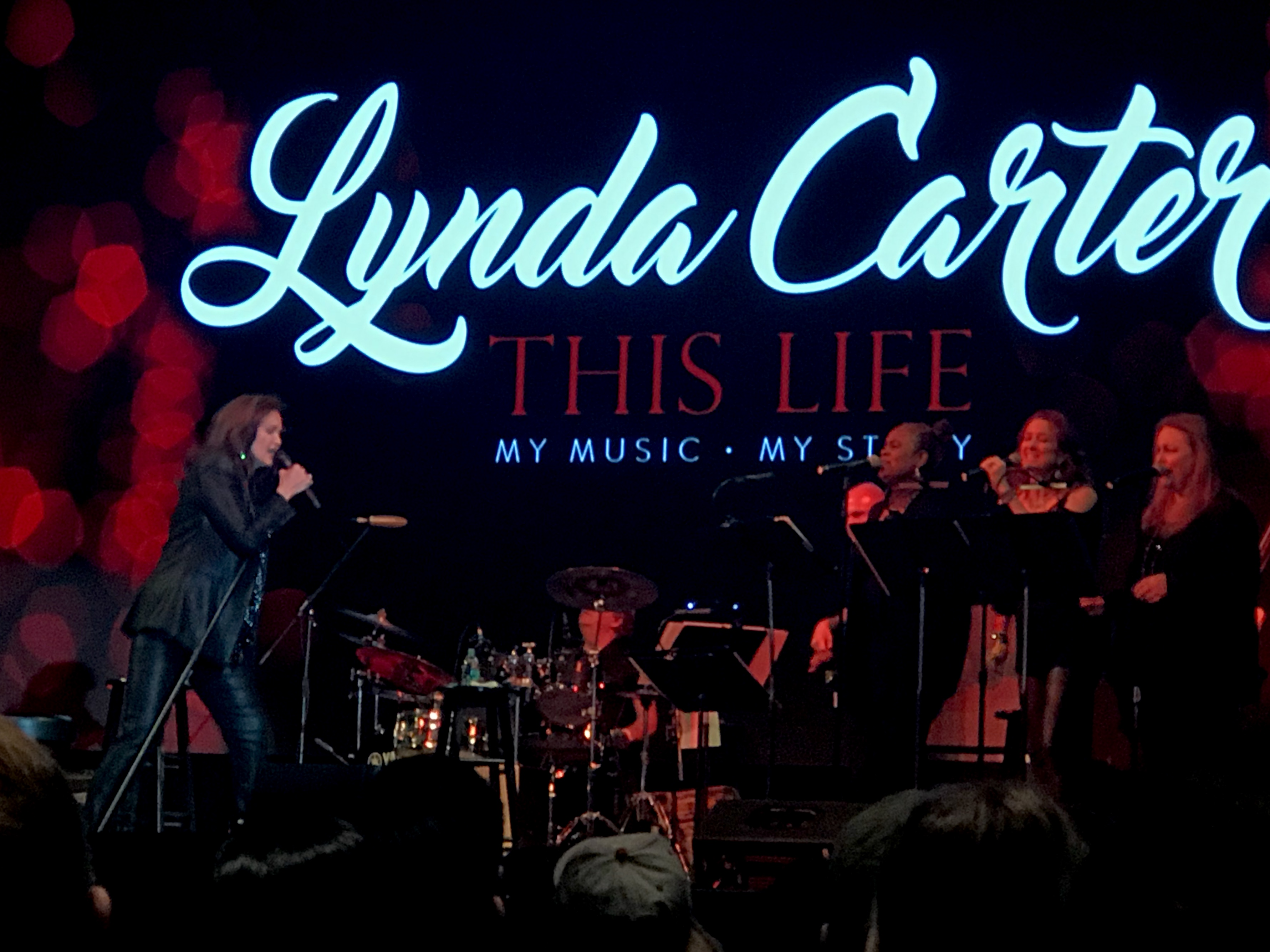 Lynda Carter and her band perform at FanX's Spring Event on April 19, 2019{ }(Photo: Ryan Michael Painter){ }