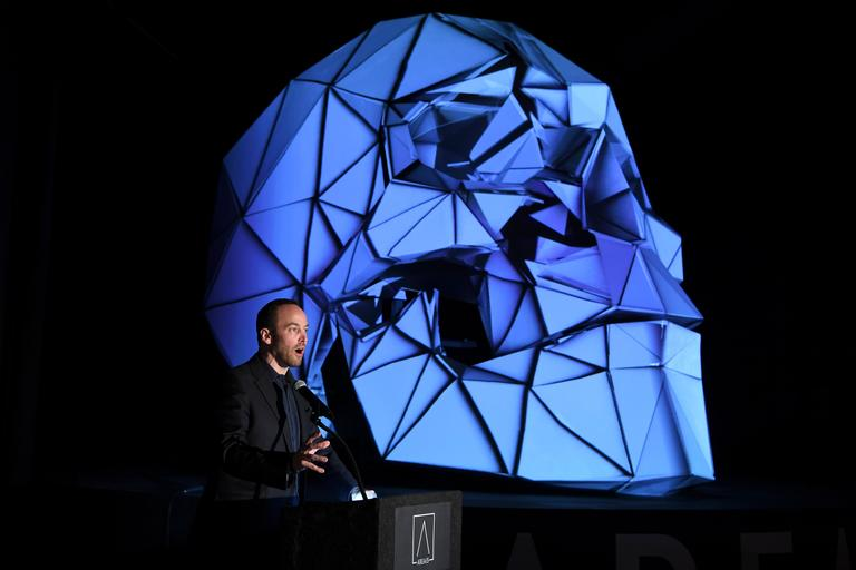 Developer Winston Fisher speaks next to a 3-D projection skull during an event announcing the establishment of Area 15, a curated retail, dining and immersive entertainment venue, Thursday, January 18, 2018. CREDIT: Sam Morris/Las Vegas News Bureau