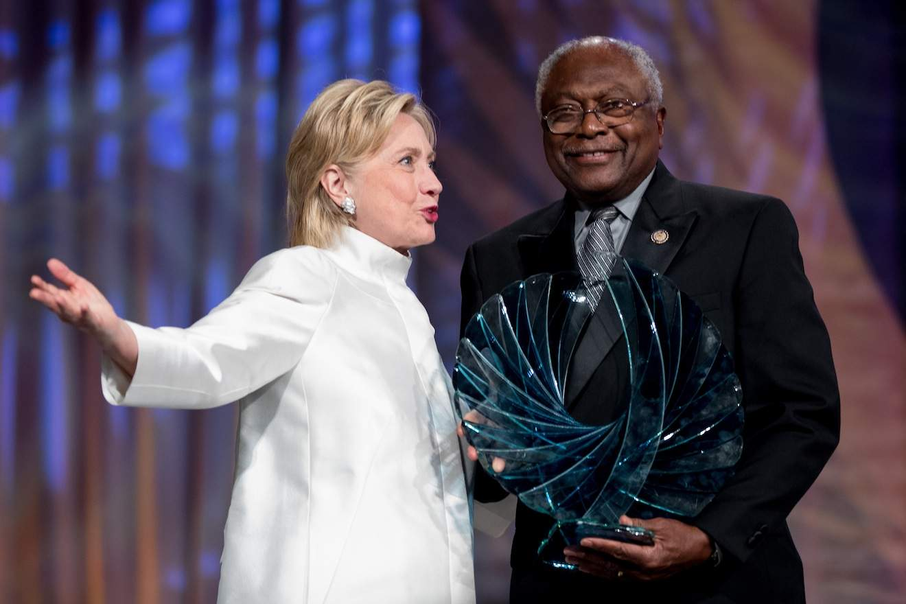 Democratic presidential candidate Hillary Clinton accompanied by James Clyburn, D-S.C., receives the Phoenix award at the Congressional Black Caucus Foundation's Phoenix Awards Dinner at the Washington Convention center, in Washington, Saturday, Sept. 17, 2016. (AP Photo/Andrew Harnik)