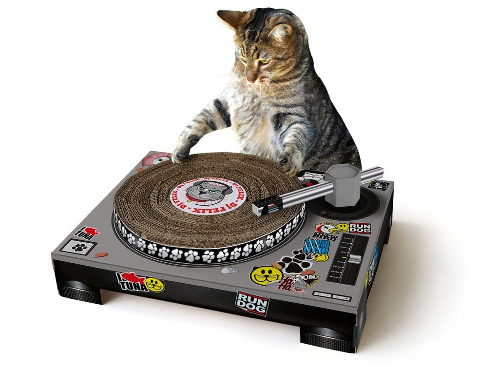 Let your feline friend show off their DJ skills with the DJ Cat Scratching Pad. They'll throw out some phat beatz while showing off their catitude. The cat smiley faces, paw prints and photos of fish-shaped cat treats will make you smile while your cat will enjoy scratching away the ole skool sounds. Designed in London, the pad comes in a flat pack cardboard kit that needs some assembly. Available to purchase on Uncommon Goods and Amazon. (Image: Amazon)