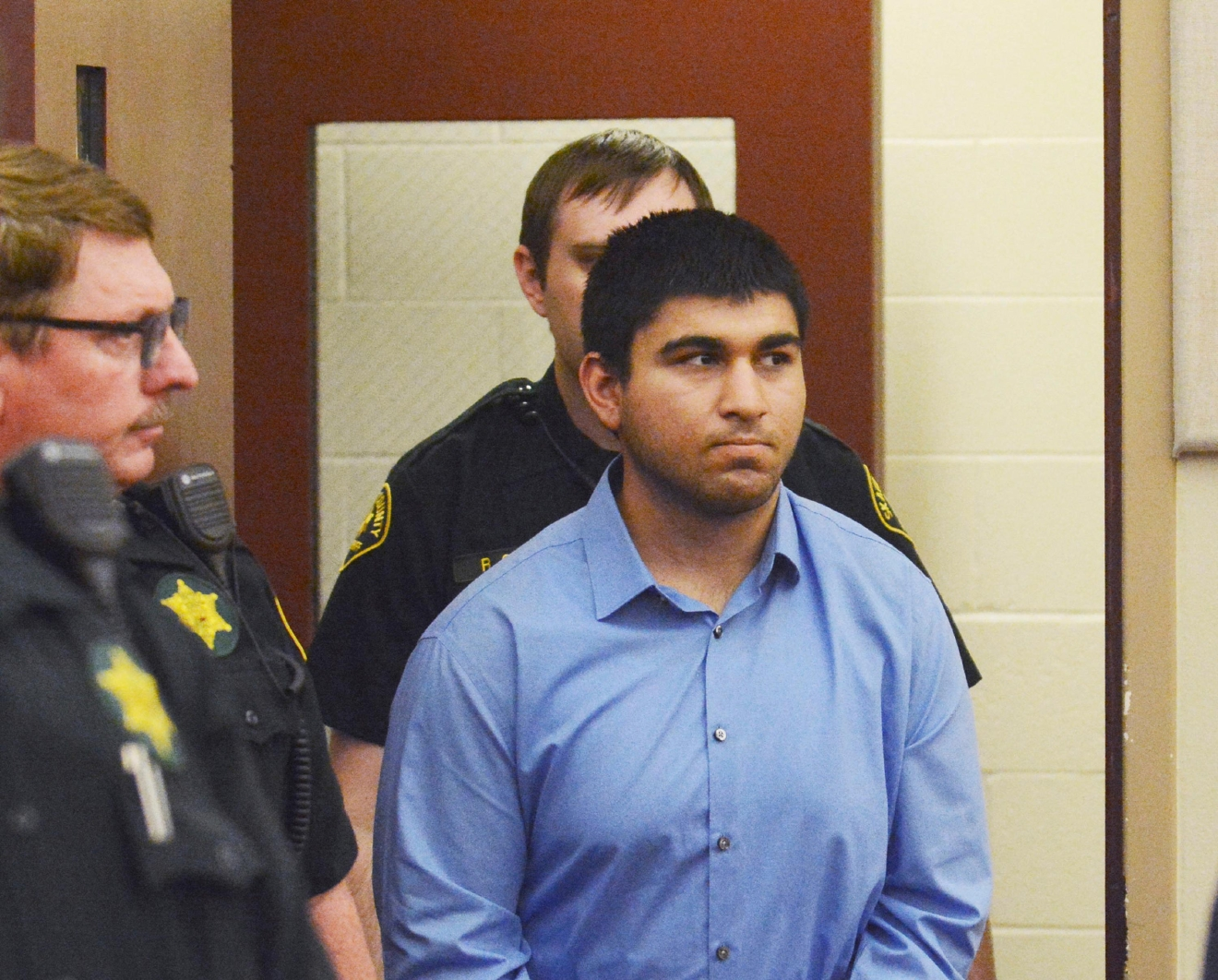 FILE - In this Monday, Sept. 26, 2016, file photo, Arcan Cetin is escorted into Skagit County District Court by Skagit County's Sheriff's Deputies, in Mount Vernon, Wash. Prosecutors plan to file charges against Cetin in the fatal shootings of five people at a Washington state shopping mall. (Brandy Shreve/Skagit Valley Herald via AP, File)