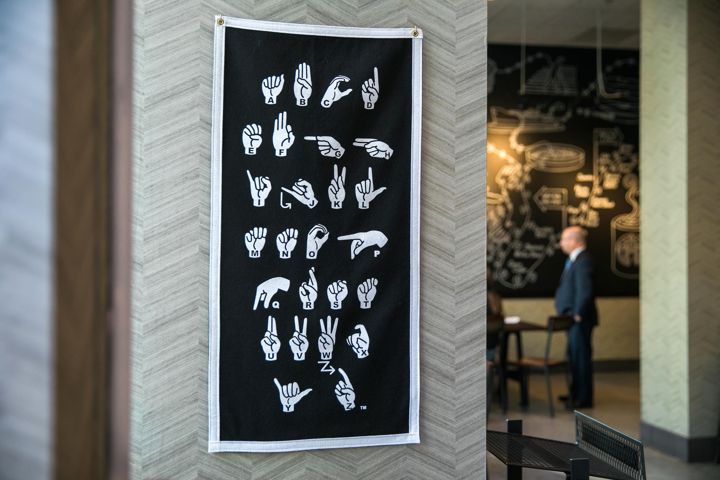 The store will feature &quot;sign of the week&quot; lessons to encourage patrons to learn a little ASL. (Image: Joshua Trujillo, Starbucks)<p></p>