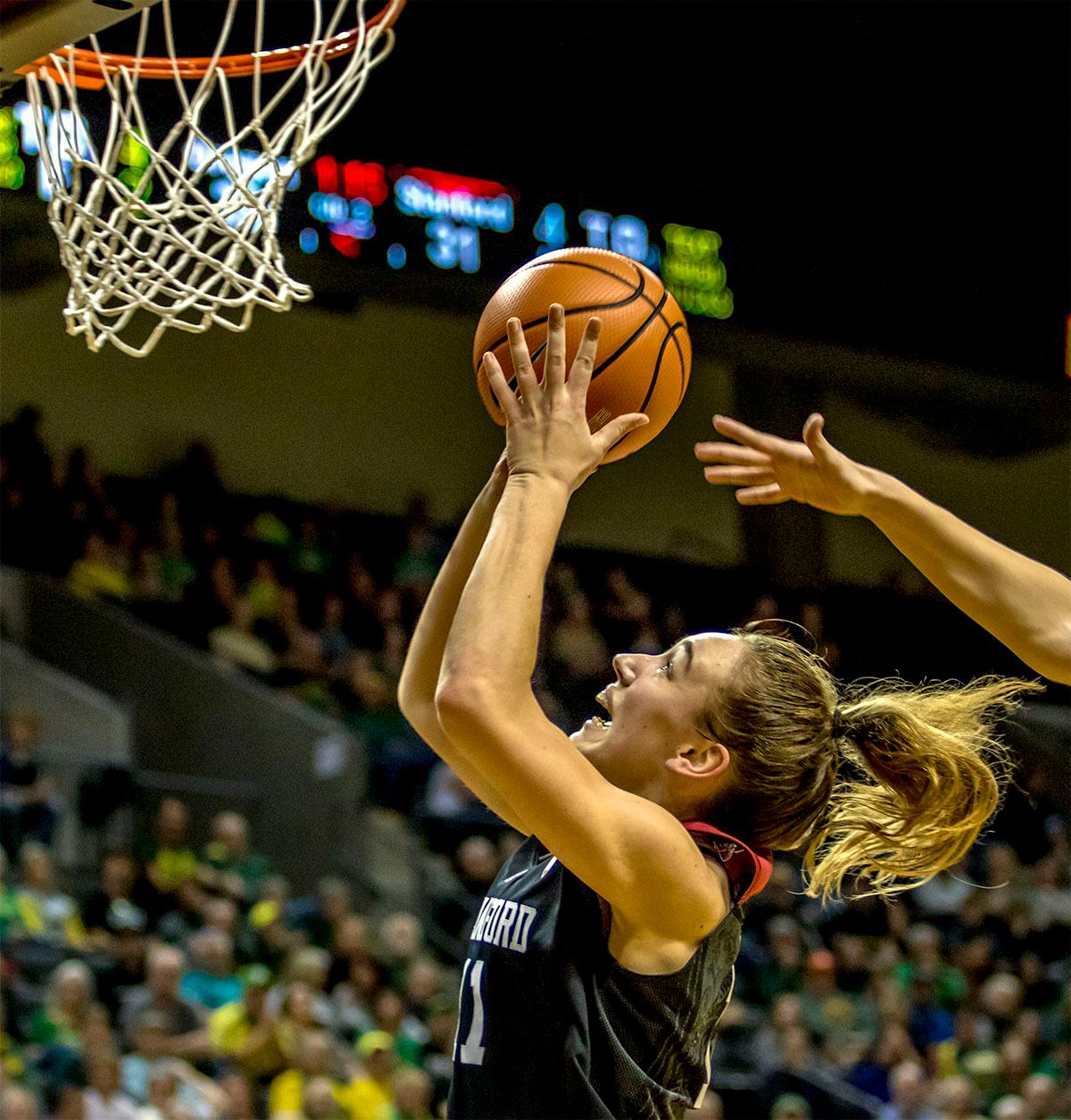 The Cardinal's Alanna Smith (#11) goes up for the basket. The Stanford Cardinal defeated the Oregon Ducks 78-65 on Sunday afternoon at Matthew Knight Arena. Stanford is now 10-2 in conference play and with this loss the Ducks drop to 10-2. Leading the Stanford Cardinal was Brittany McPhee with 33 points, Alanna Smith with 14 points, and Kiana Williams with 14 points. For the Ducks Sabrina Ionescu led with 22 points, Ruthy Hebard added 16 points, and Satou Sabally put in 14 points. Photo by August Frank, Oregon News Lab