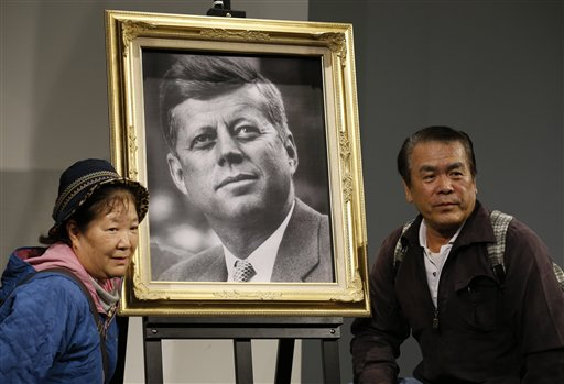 A Japanese couple pose with a portrait of the late U.S. President John F. Kennedy at a memorial venue specially set for his Japanese fans in Tokyo.