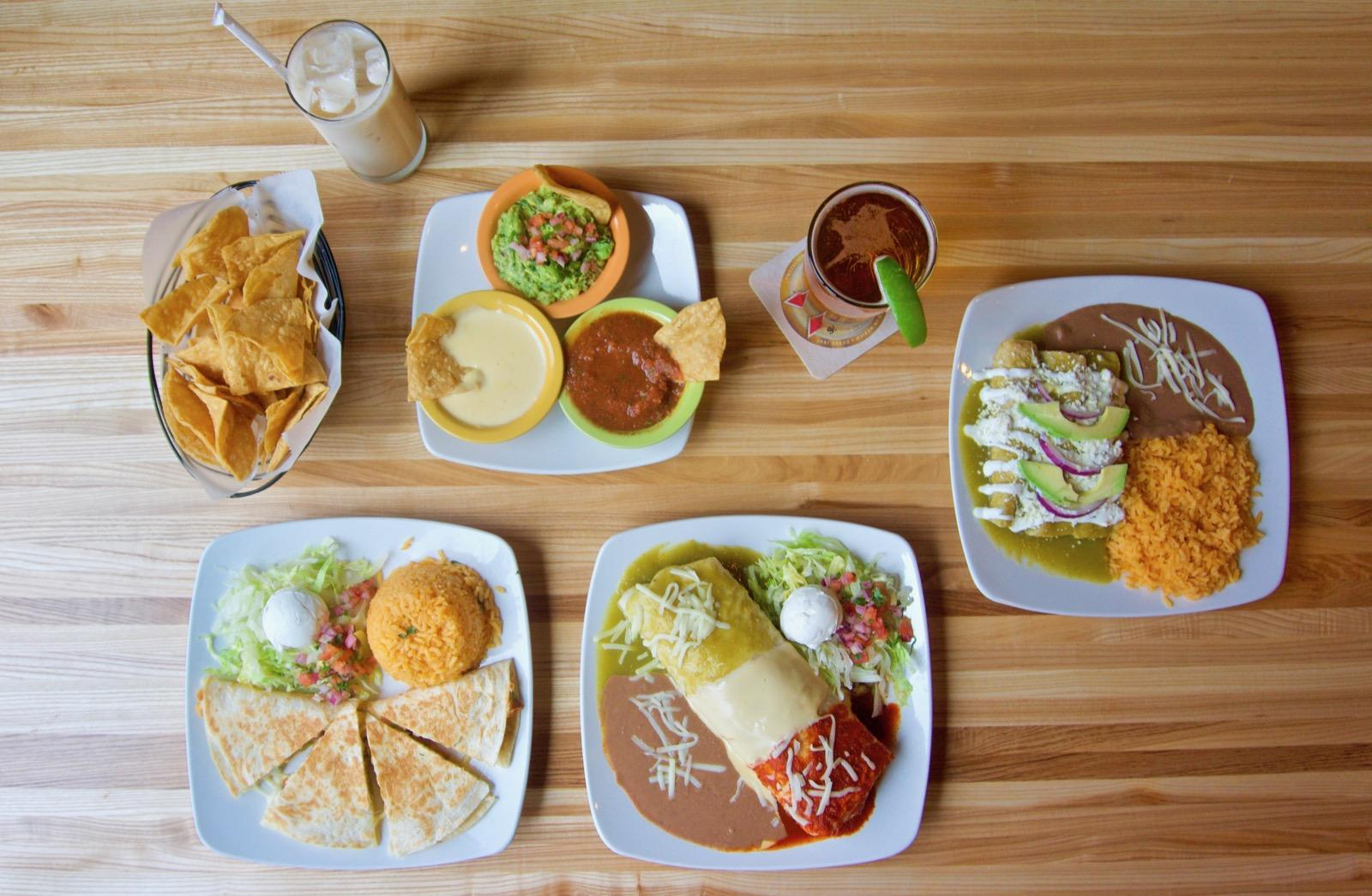 Chicken enchiladas, supreme chicken quesadilla, burrito Mexicano, chips with salsa, queso, and guacamole, Horchata, and a Dos Equis / Image: Brian Planalp // Published: 1.29.18<p></p>
