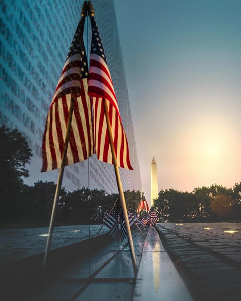 A flag to celebrate Independence Day at the Vietnam War Memorial. (Image via @nayebphotography)