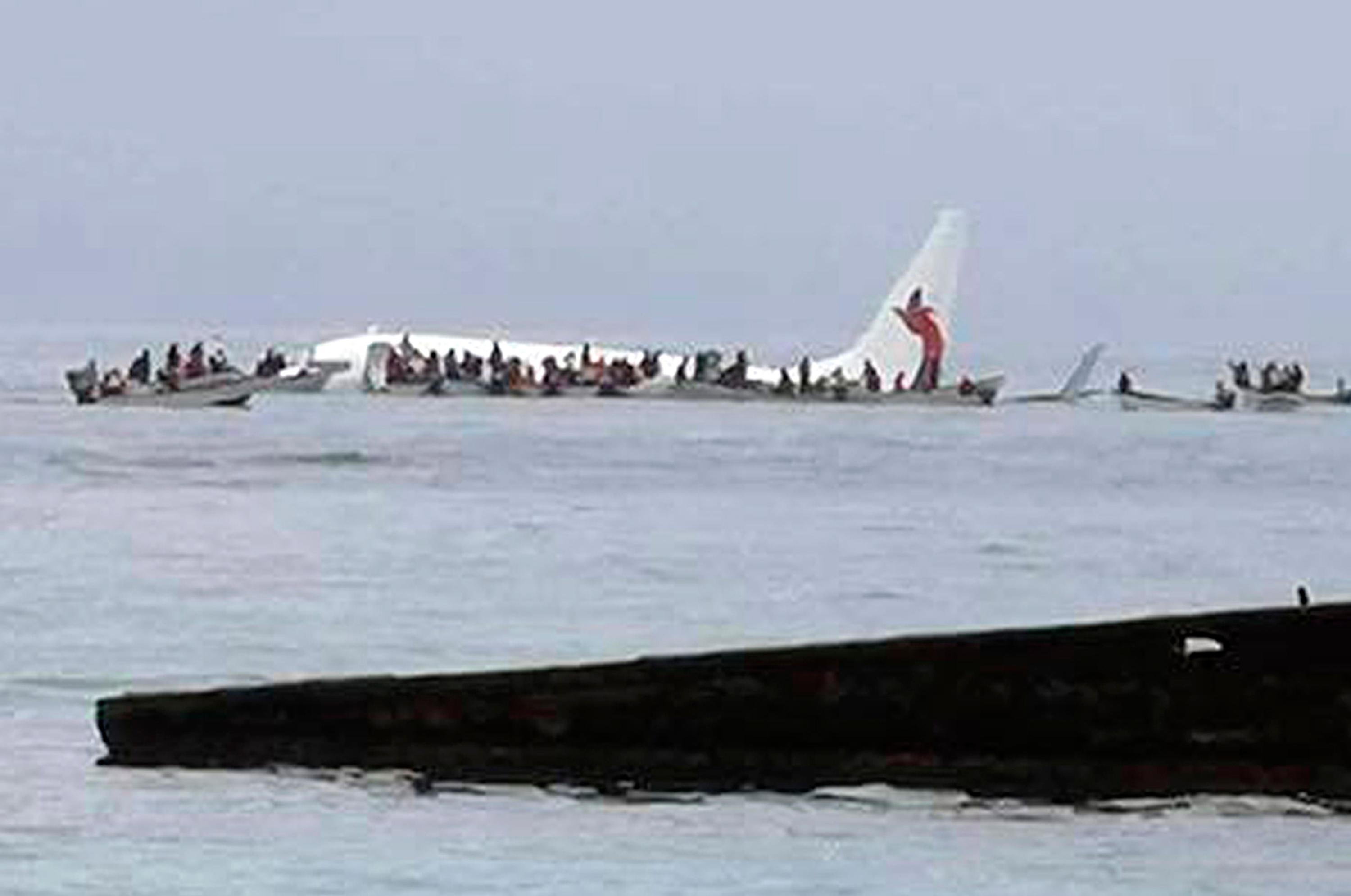 This photo provided by Blue Flag Construction shows an Air Niugini plane floating in Pacific lagoon after its crash-landing in Pacific lagoon near Chuuk Airport in Weno, Federated States of Micronesia, Friday, Sept. 28, 2018. All of the passengers and crew survived the crash landing. The Air Niugini plane hit the water short of the runway while trying to land at Chuuk Island, according to the airline. (Blue Flag Construction via AP)