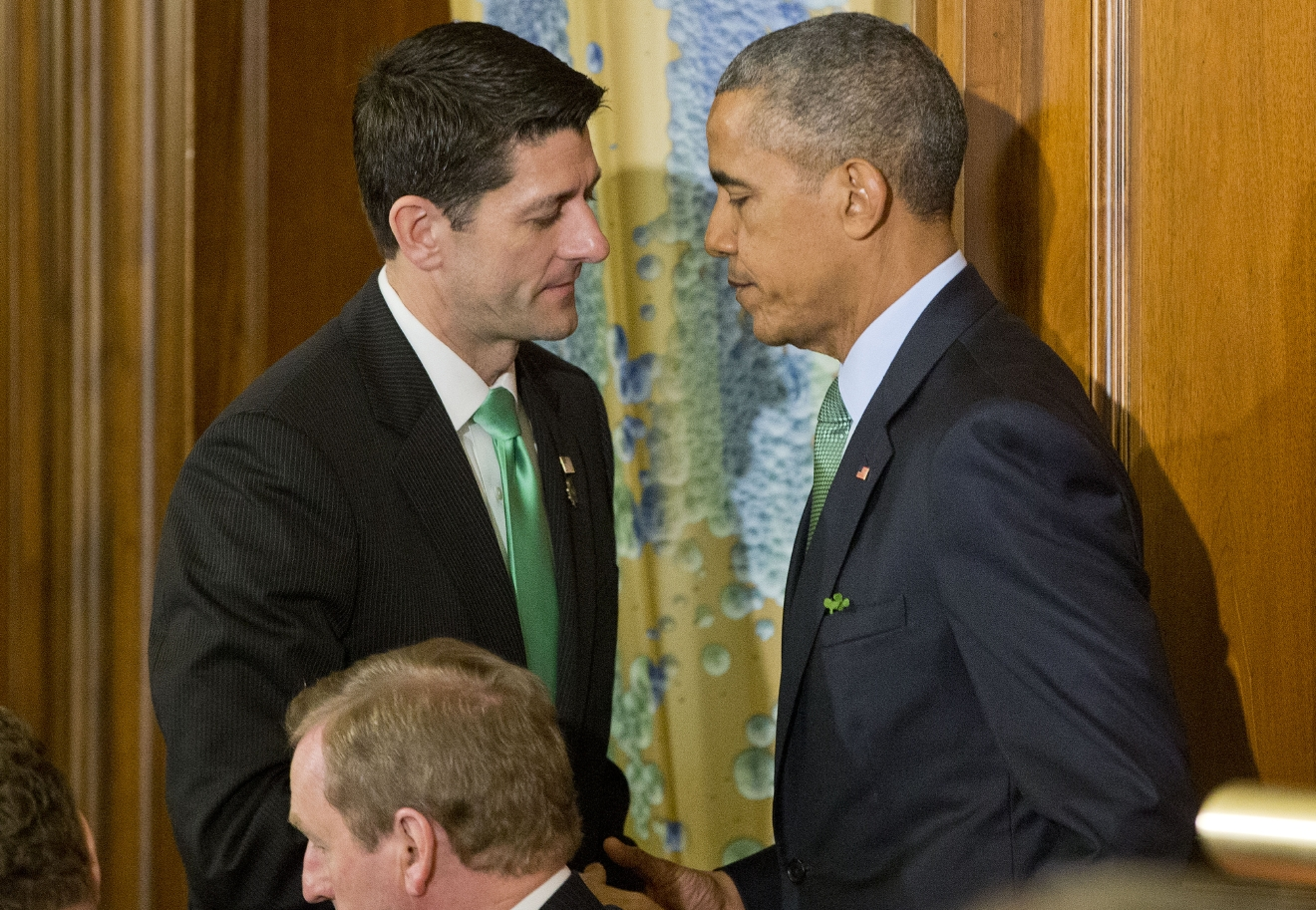 President Barack Obama, right, and House Speaker Paul Ryan of Wis., left, shake hands during a lunch celebrating St. Patrick's Day for Irish Prime Minister Enda Kenny, center, on Capitol Hill in Washington, Tuesday, March 15, 2016. (AP Photo/Pablo Martinez Monsivais)