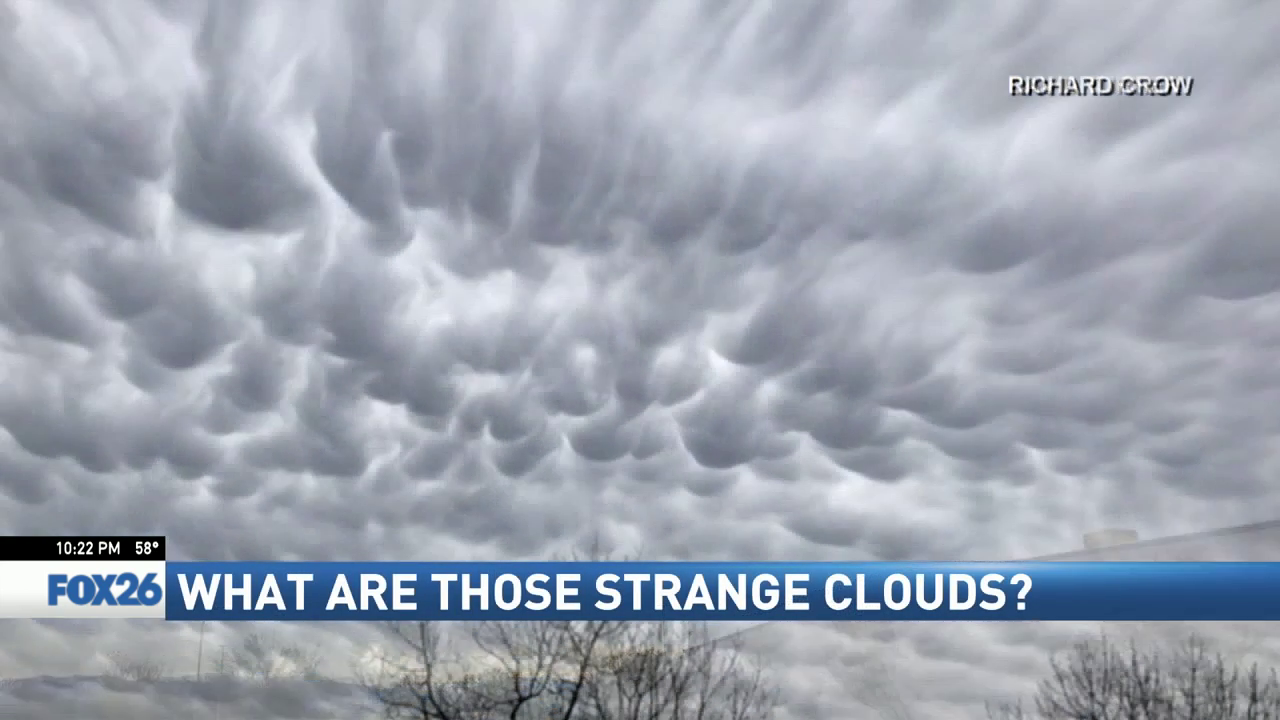 Meteorologist Kevan Ramer explains what the strange cloud cover was all about. (Photo by Richard Crow)
