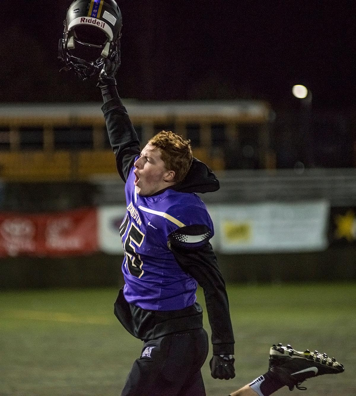 A Hermiston Bulldogs player celebrates his team's win.The Hermiston Bulldogs defeated the Churchill Lancers 38-35 for the 5A state title Saturday evening at Hillsboro Stadium. Photo by Abigail Winn, Oregon News Lab