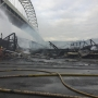 Three-alarm warehouse fire rains embers onto Fremont Bridge, closes down area