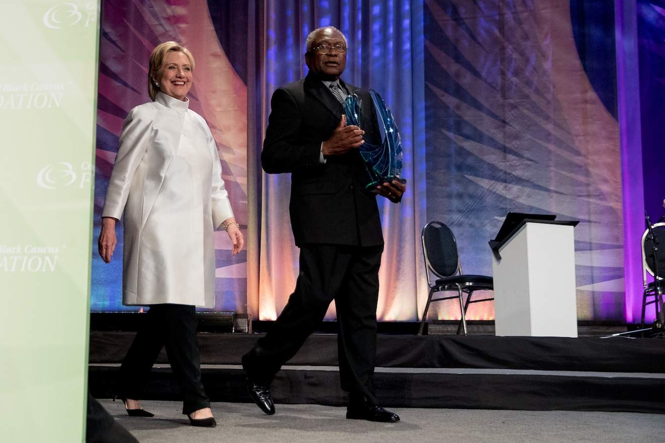 Democratic presidential candidate Hillary Clinton accompanied by James Clyburn, D-S.C., right, takes the stage to receive a Phoenix award at the Congressional Black Caucus Foundation's Phoenix Awards Dinner at the Washington Convention center, in Washington, Saturday, Sept. 17, 2016. (AP Photo/Andrew Harnik)
