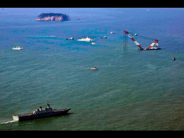 An aerial view shows South Korean ships conducting search and rescue operations, April 20, 2014, for the Sewol, the ferry that sank April 16 off off Jindo island. U.S. sailors and Marines are assisting in the search.