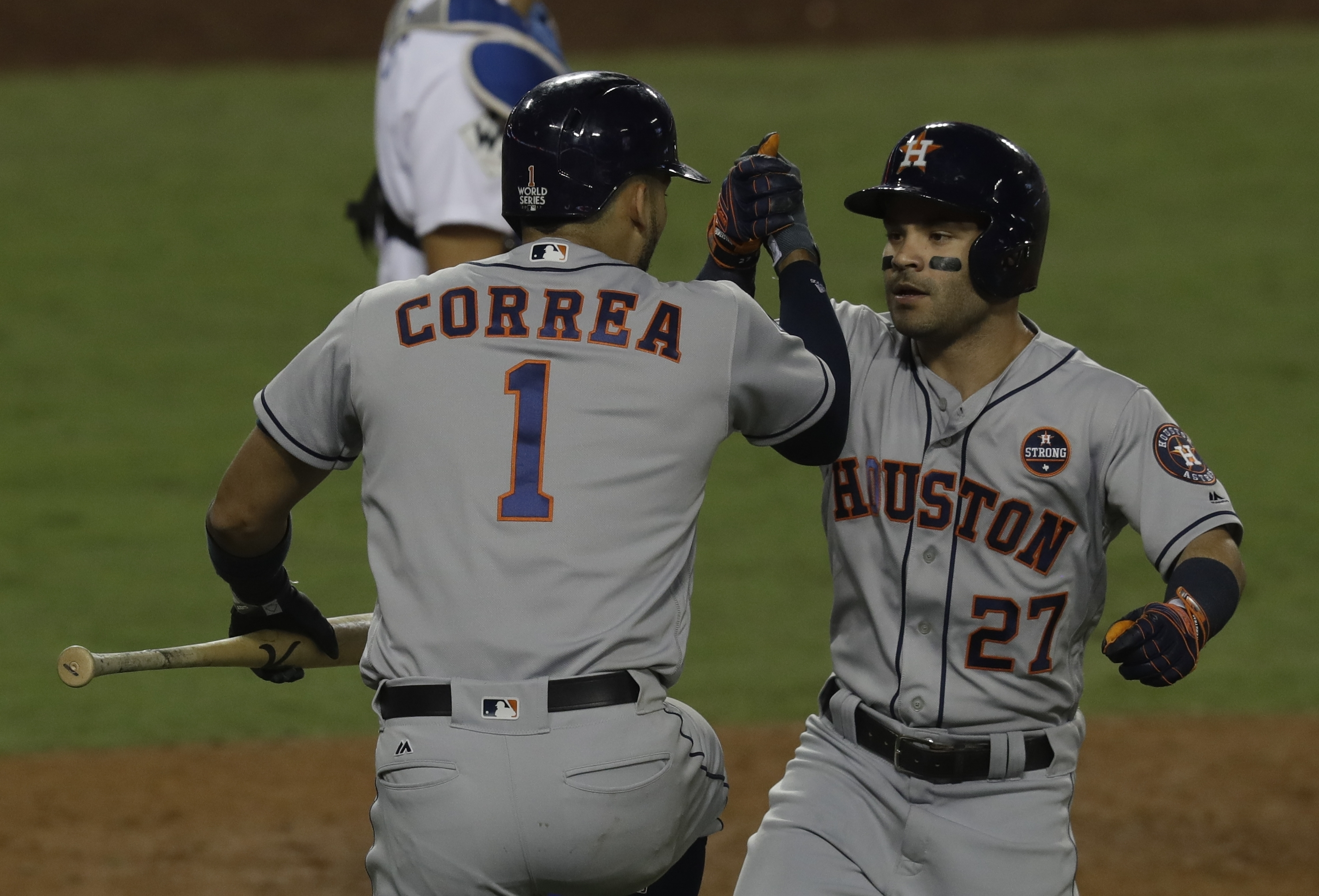 Houston Astros' Jose Altuve is congratulated by Carlos Correa after hitting a home run during the 10th inning of Game 2 of baseball's World Series against the Los Angeles Dodgers Wednesday, Oct. 25, 2017, in Los Angeles. (AP Photo/Alex Gallardo)