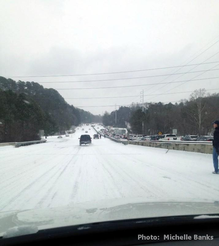 Motorists travel west on both sides of Highway 280 near the Brookwood Mall during a winter storm, Tuesday, January 28, 2014.
