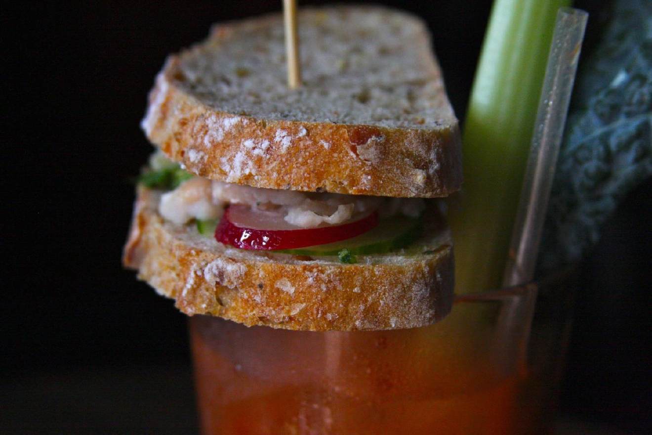Brandon adds the sandwich to the Bloody Mary / Image: Molly Paz