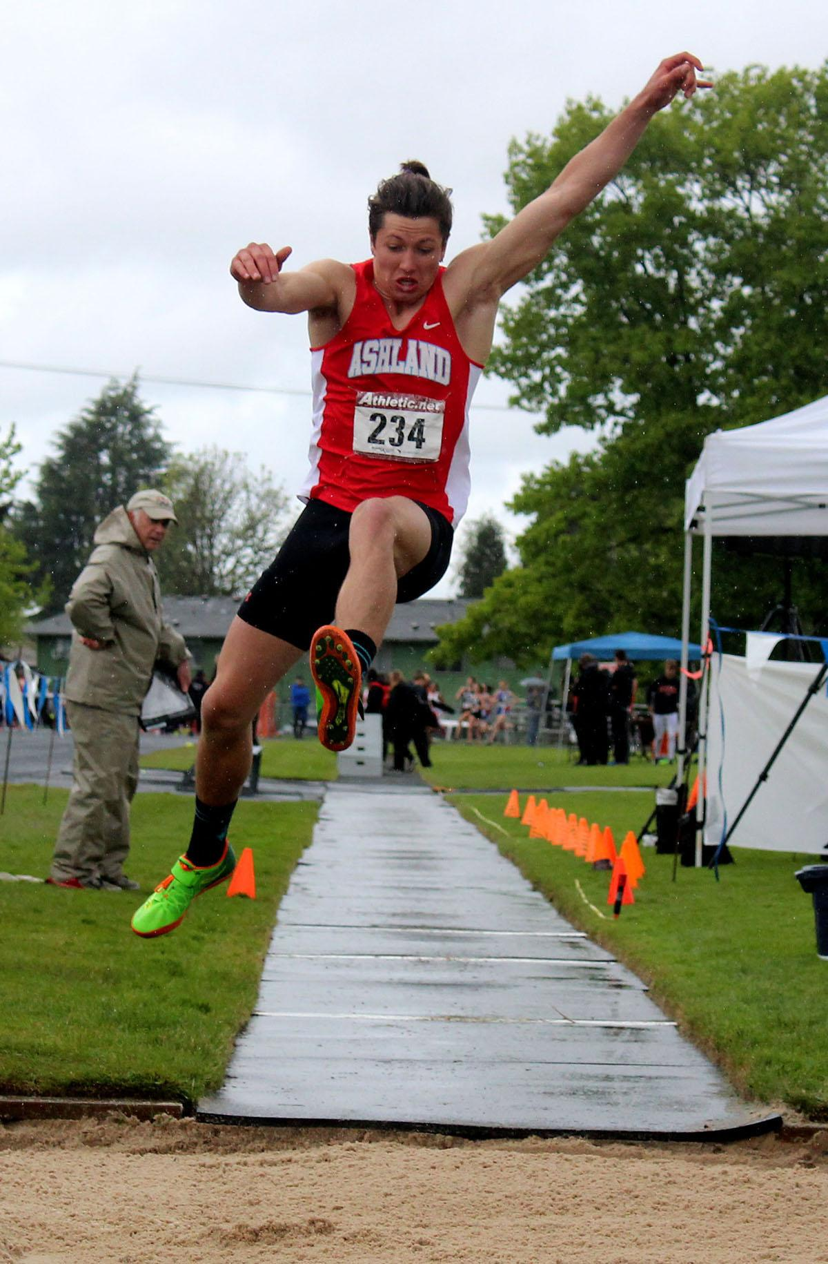 A triple jumper gives it his all at the 5A-3 Midwestern League District Track Championship meet. Photo by Elle Page, Oregon News Lab