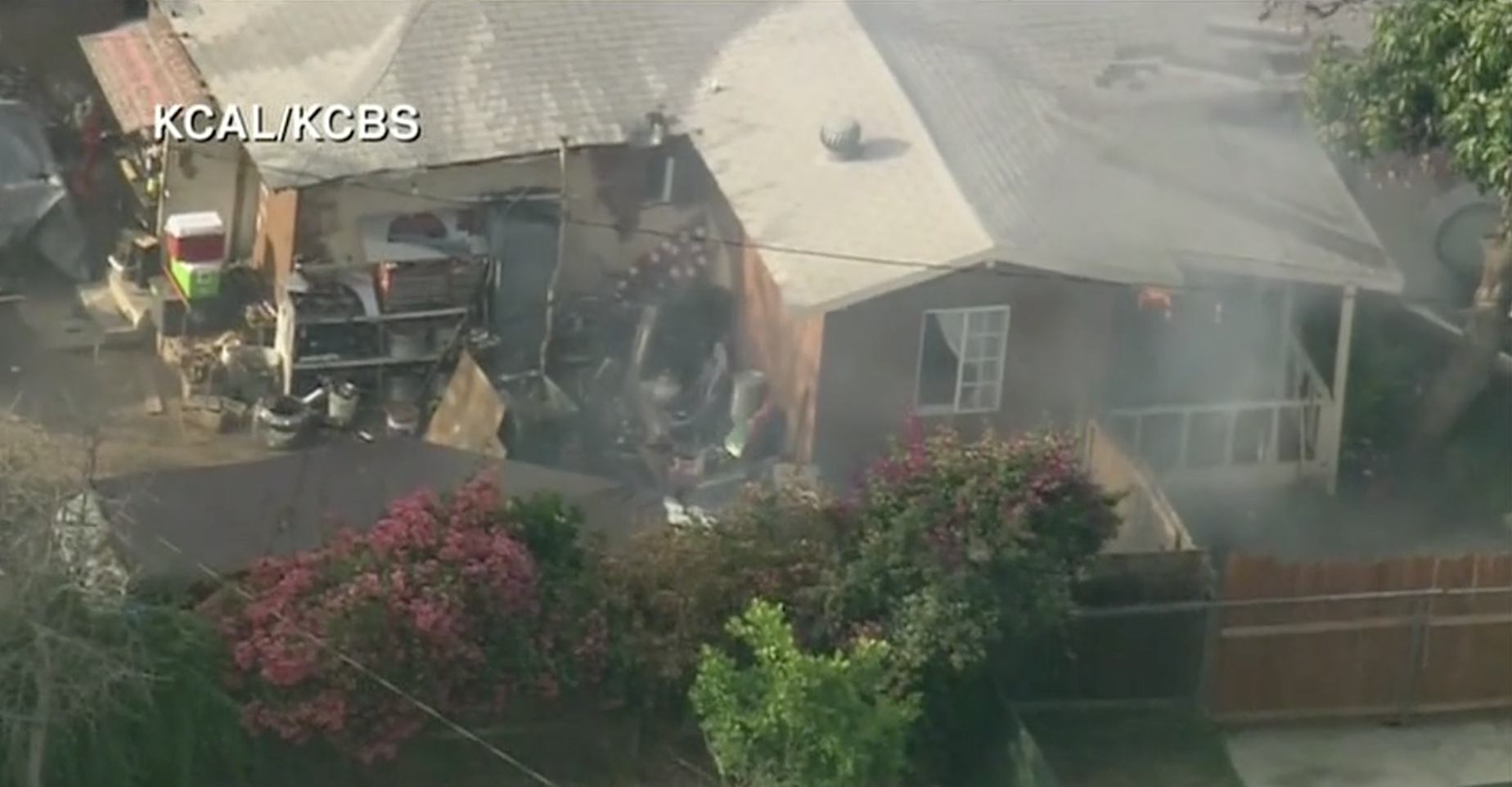 Watch: Barricade situation in California turns into a house fire (KTLA via CNN Newsource)